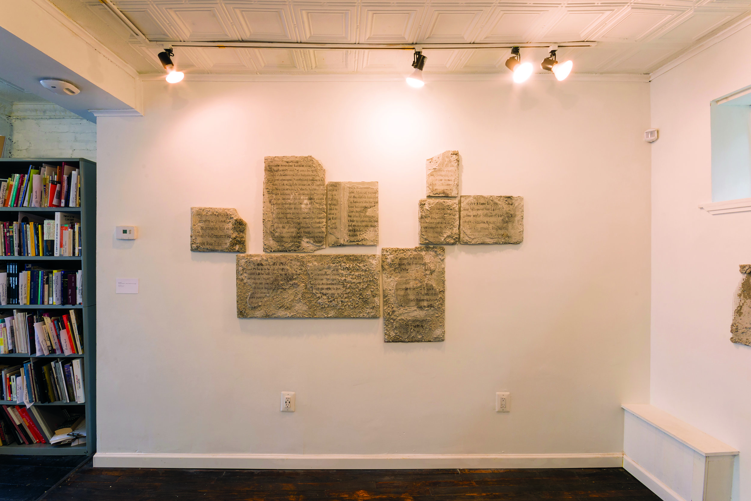 Sera Boeno,  Kelimeler Kıyafetsiz (: Words Naked/Are Not Enough),  2016–ongoing. Cement, charcoal, pigment. Each slab ~70 x 35 cm.  Photos by Michael Bussell (unless otherwise noted).