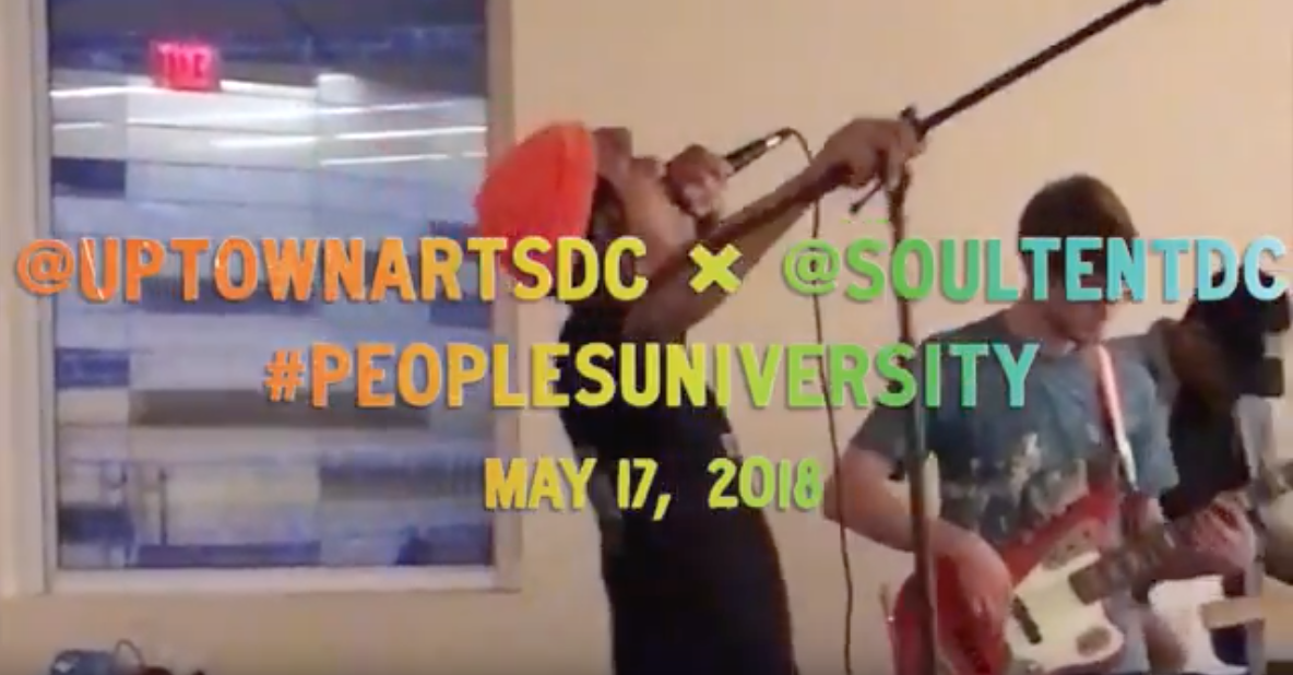Still from video of a performance by Uptown Art House
