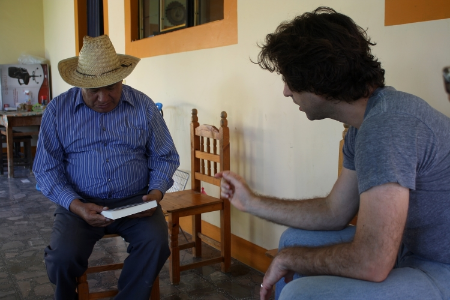 Presenting the results of a previous survey to an inhabitant of San Miguel Tlacotepec, Oaxaca, Mexico.