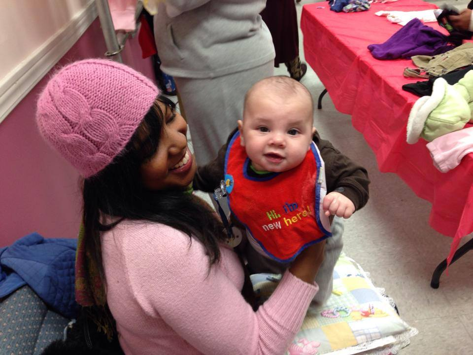 "Zinia Hargrove holding an aheart baby at the ""be my valentine baby"" event."