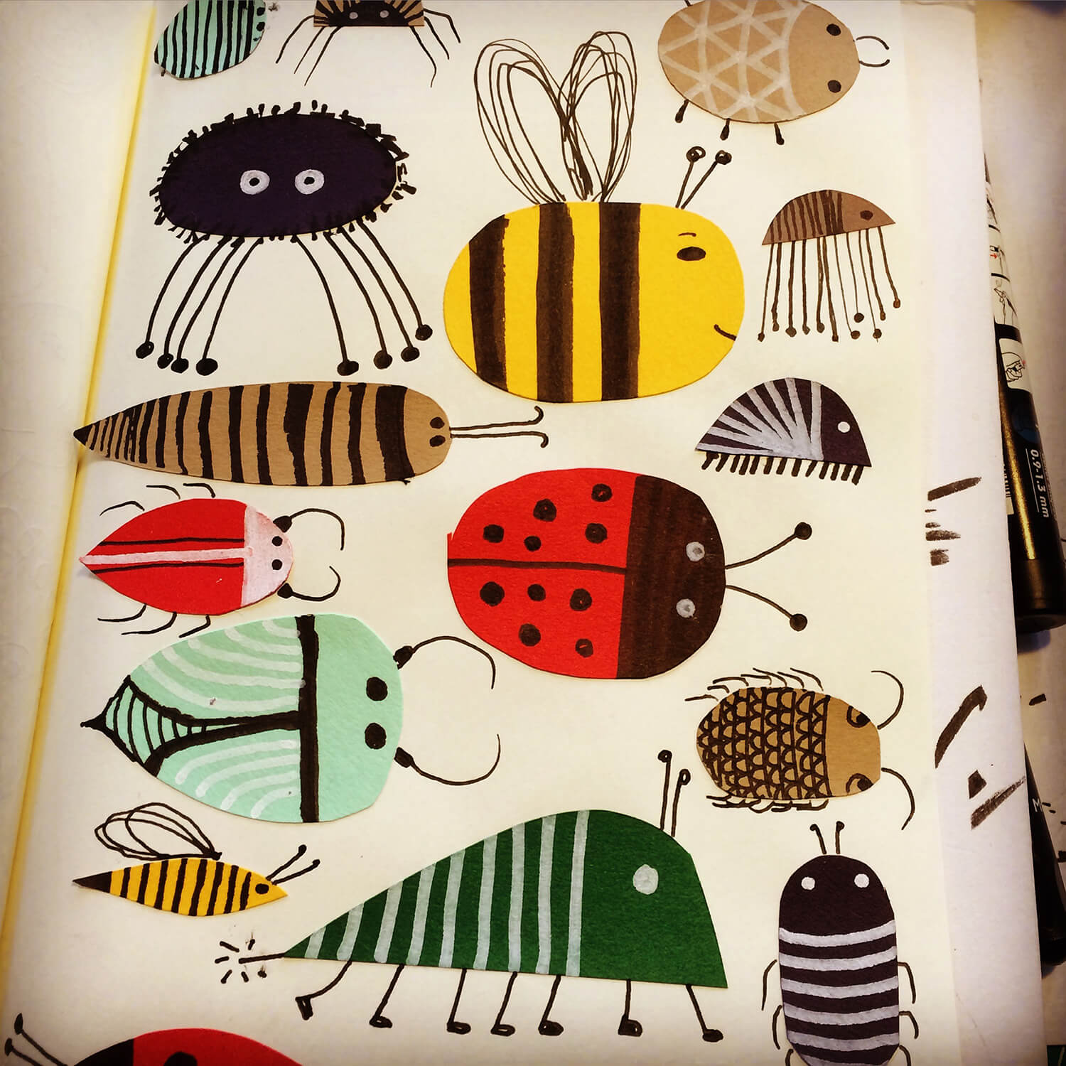 Sketchbook bugs. Cut paper shapes and pen.