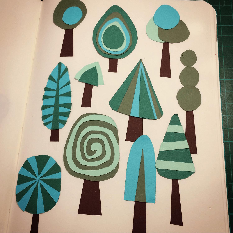 Cut paper trees.