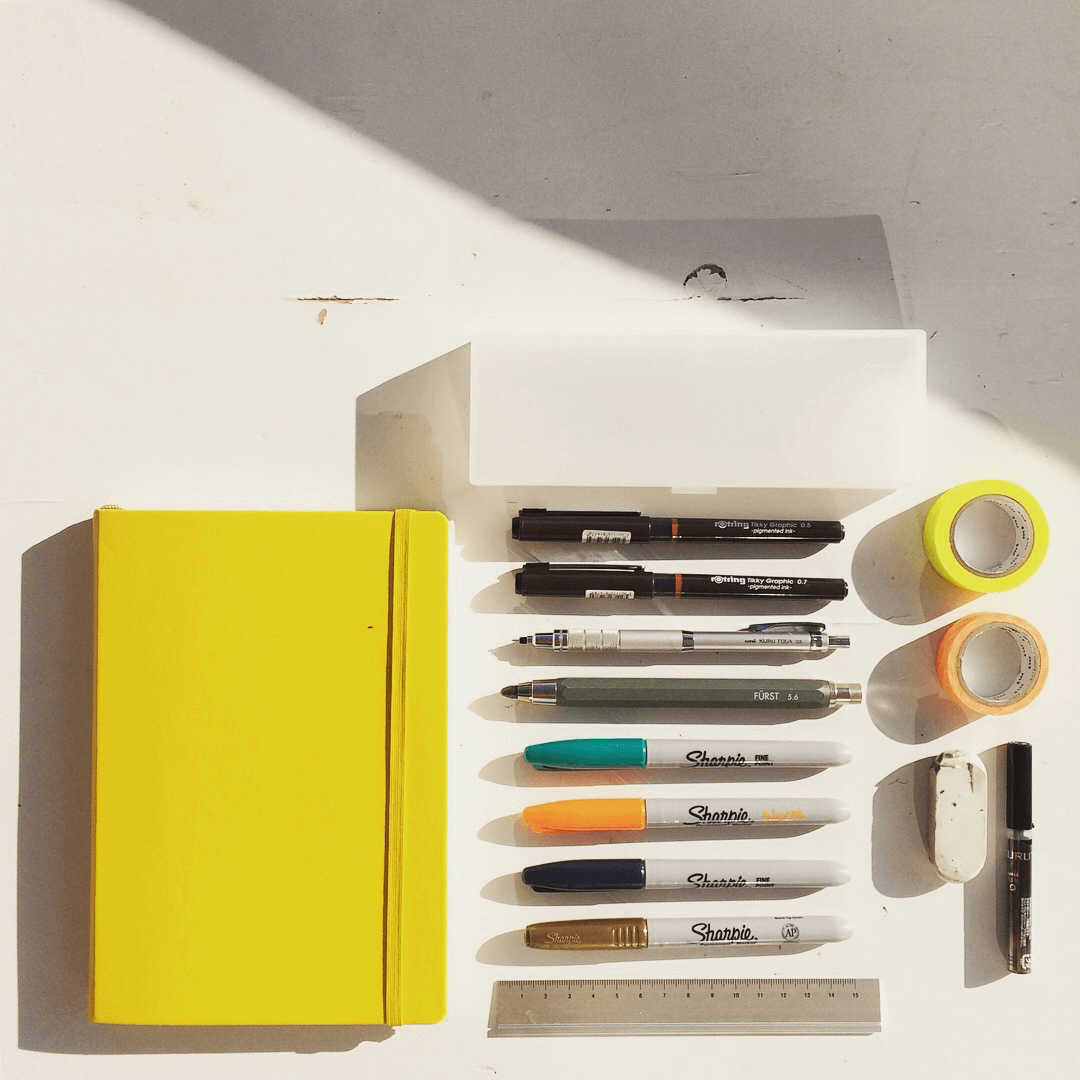 Sketchbook and pens.png