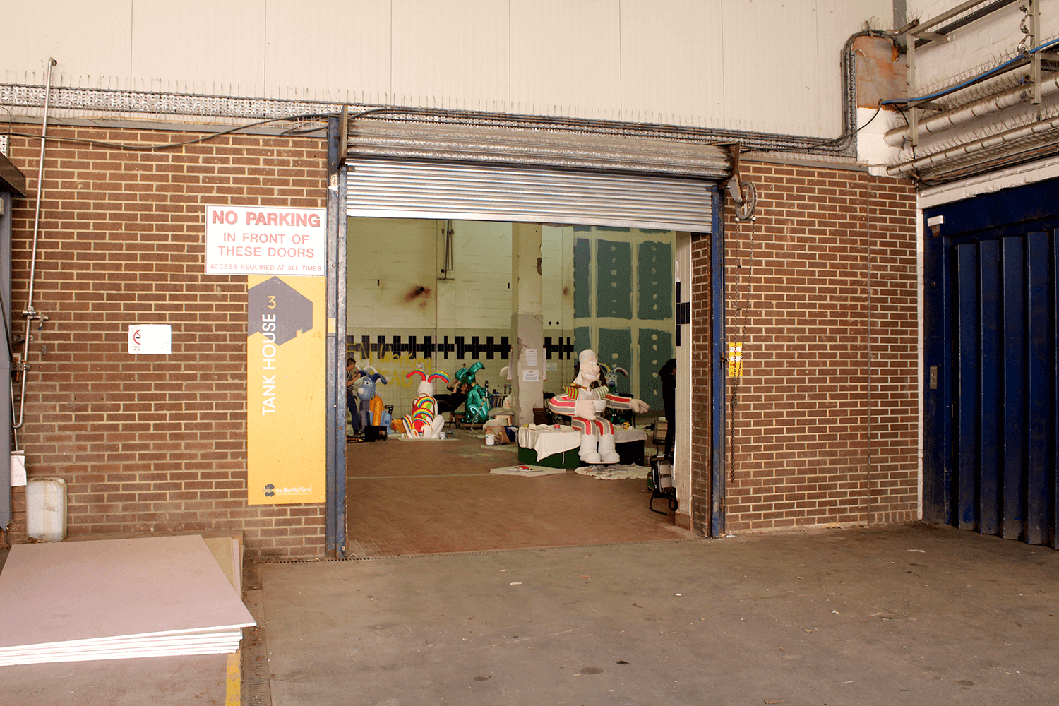 The painting space populated with Gromits, Wallace, and Feathers, in various stages of completion