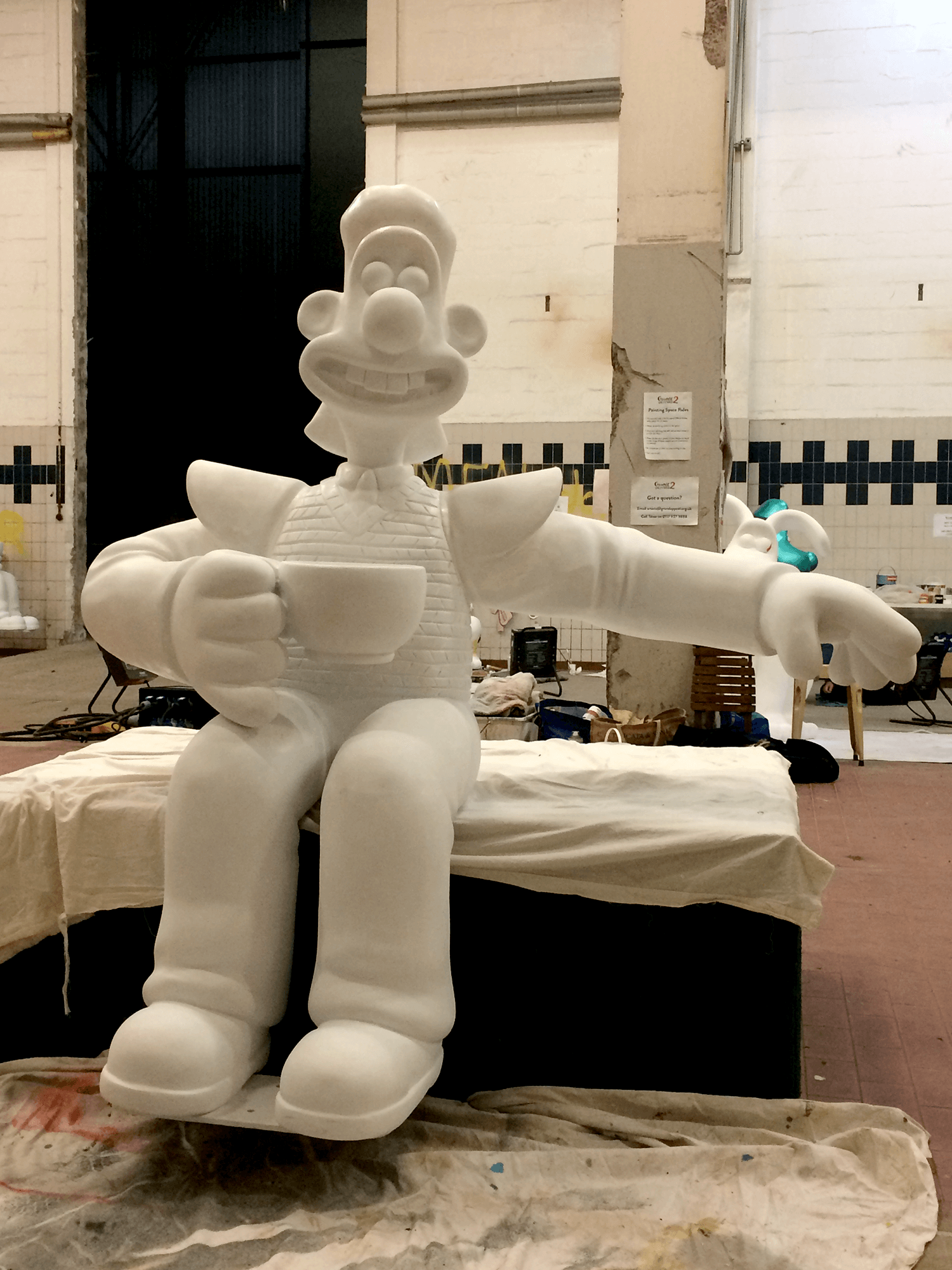 The 'blank' Wallace sculpture. He has his arm out like that because on the trail he will be sitting on a bench, welcoming trail visitors to join him!