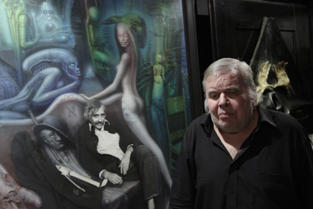 "HR Giger in front of his work ""Friedrich Kuhn II"". It shows his friend photographed shortly before his death.   December 2011   ©   Christian Schwarz"