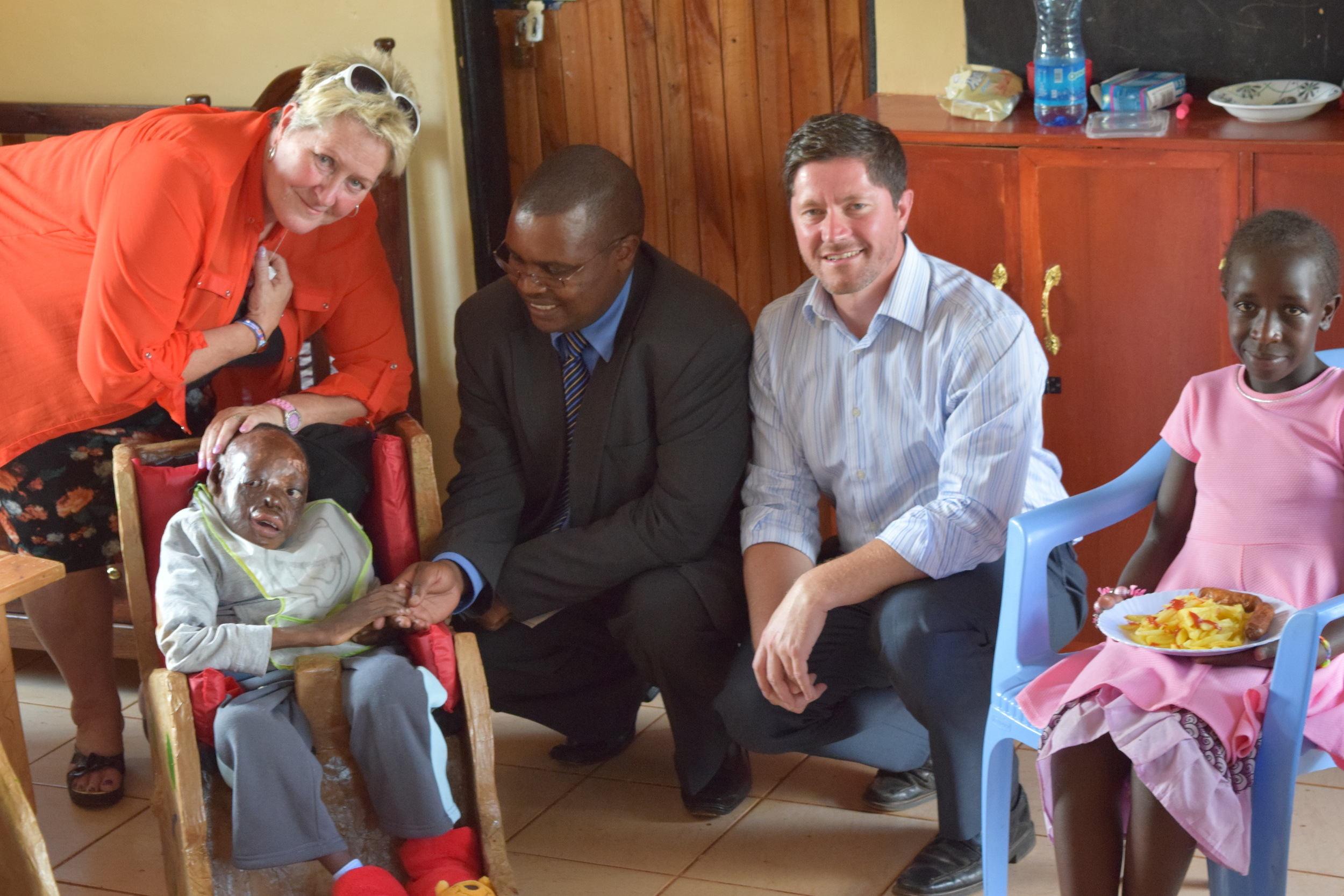 The Hon. David Mwangi Mugo (centre), the Speaker of the County Assembly of Nyeri, with Mrs Terry Fairfowl (left) and Pastor David Murray (right), meets Kenuah (front left) and Fiona (front right) in our Sanctuary day care centre.