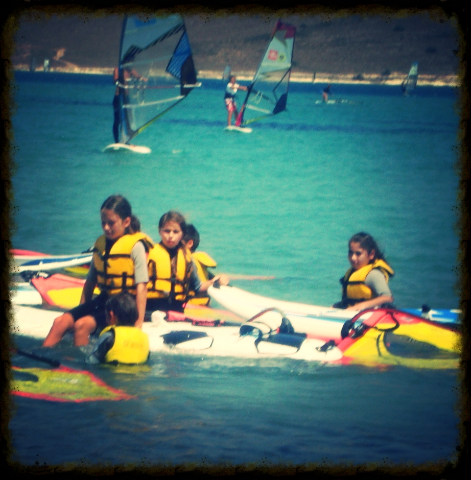 Girls are at the windsurf camp.