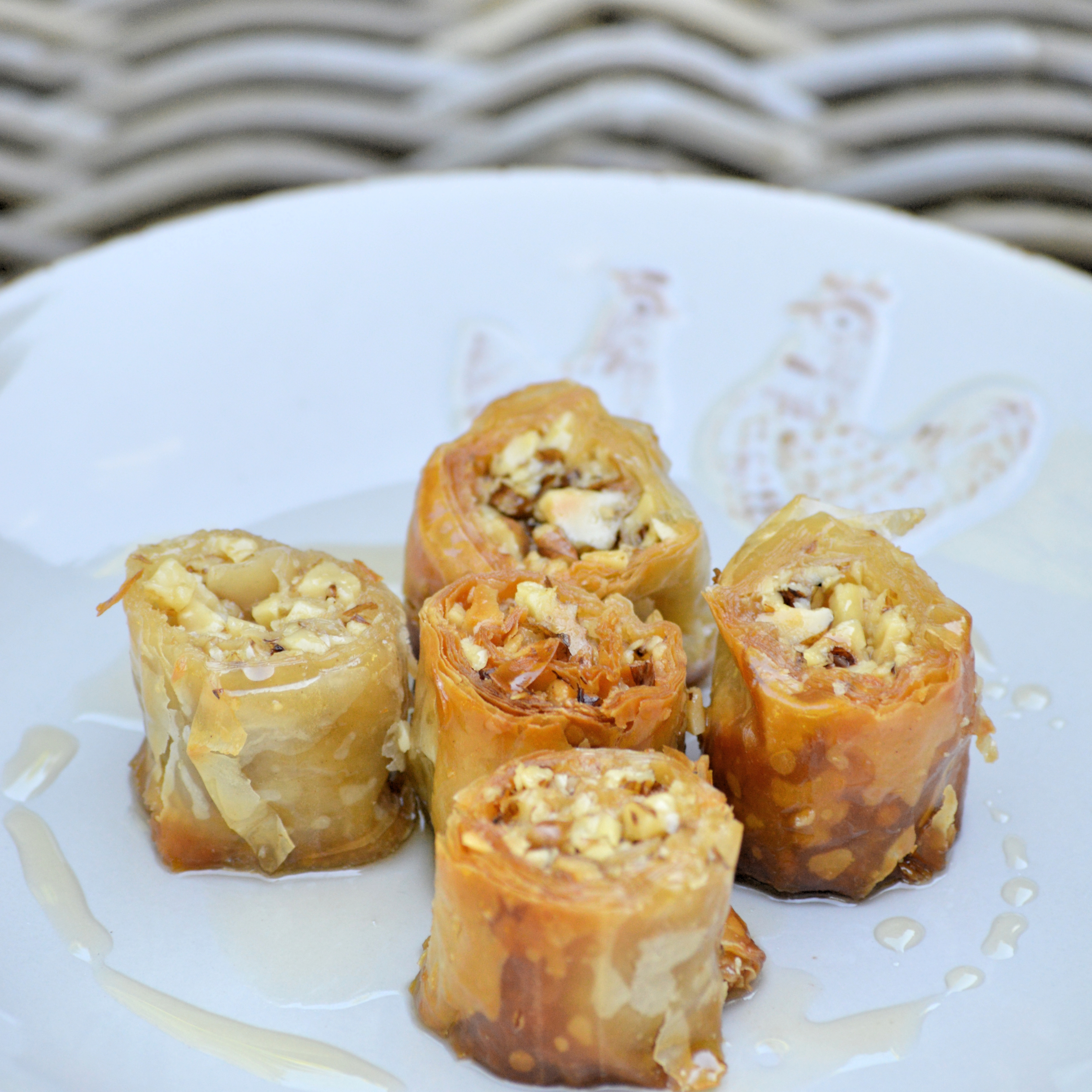 Walnut wrapped crunchy dough in honey syrup  Vegetarian