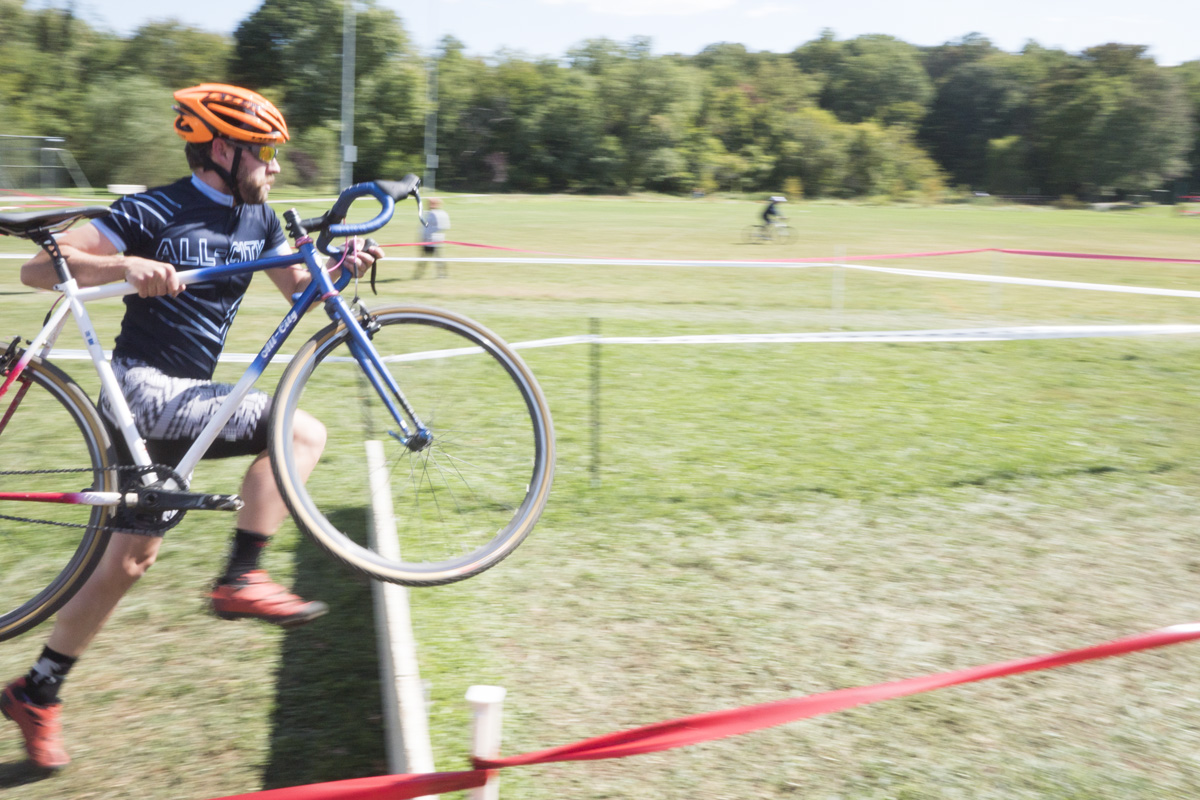 Courses often feature brief off the bike sections. Kevin and his Nature Boy leap over the barriers at Hyattsville CX.