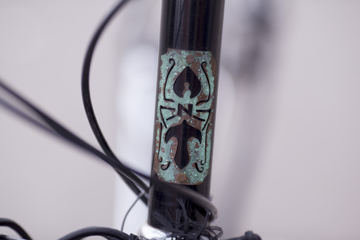 A.N.T headbadge. Made of copper and steel, just like the distillery.