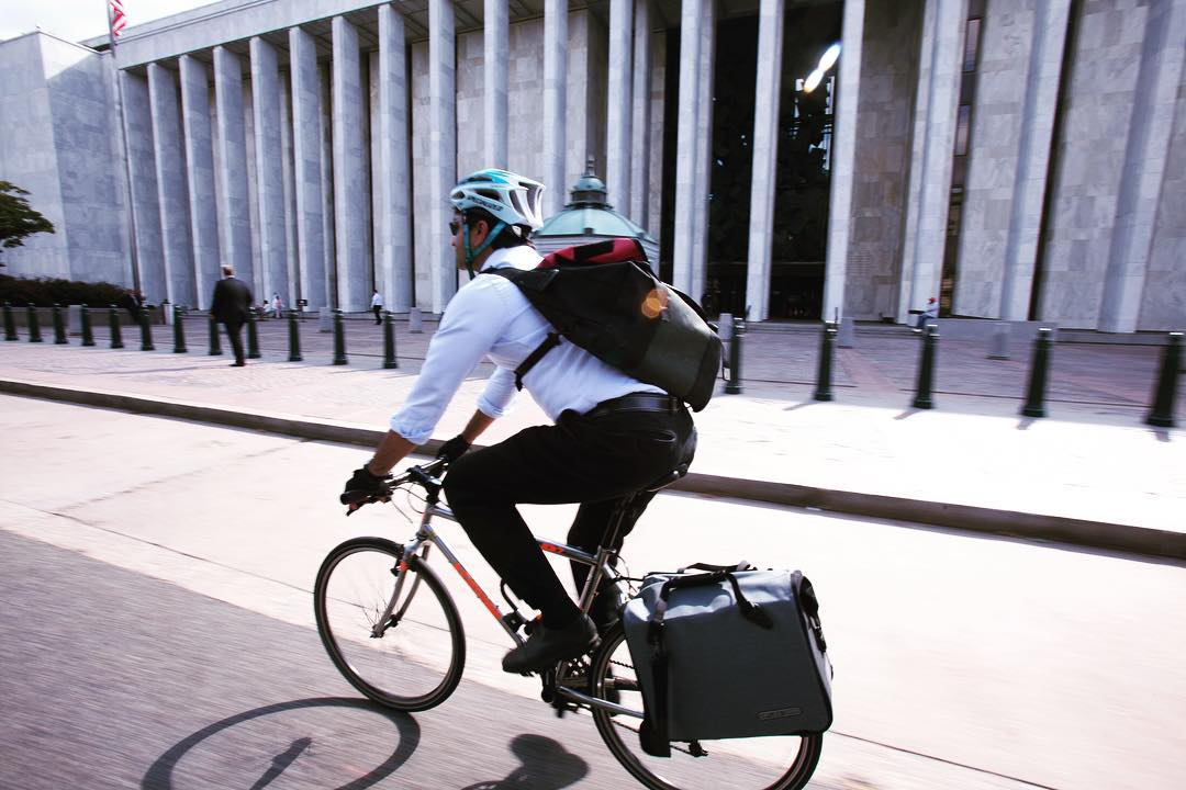 Sujith riding with an Ortlieb Commuter pannier.