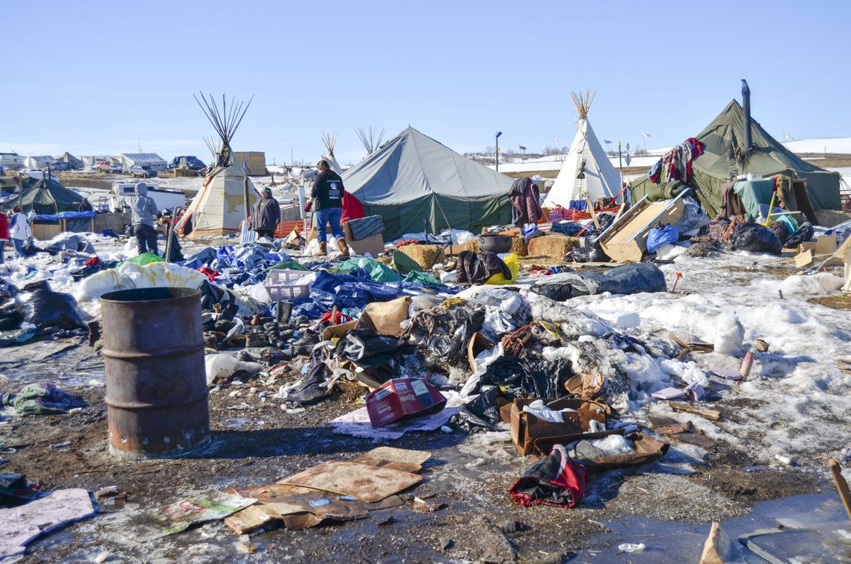 Piles of debris at the Oceti Sakowin camp, the main Dakota Access Pipeline protest camp, in North Dakota.  Amy Sisk/Inside Energy