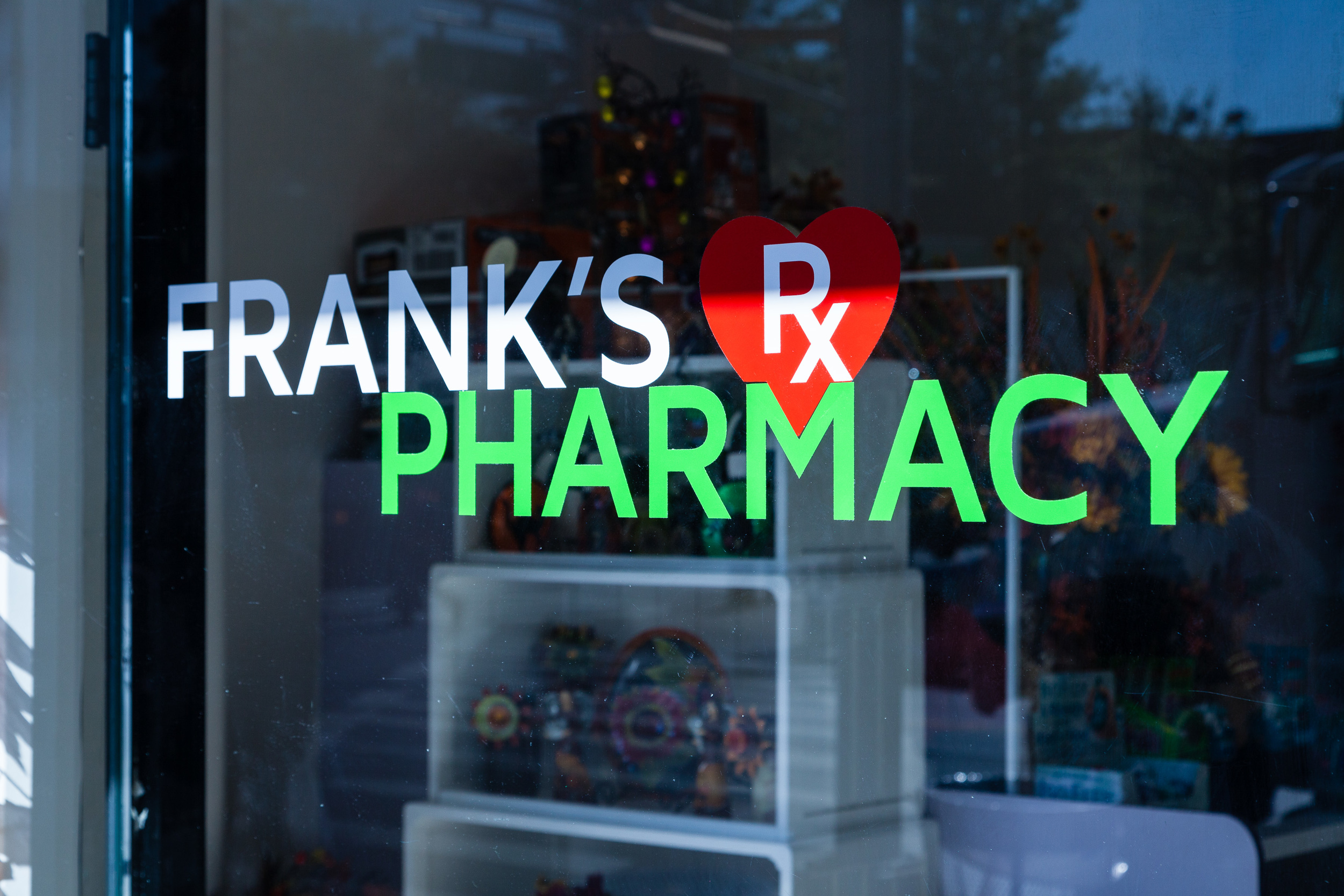 Frank's Pharmacy Exterior Logo
