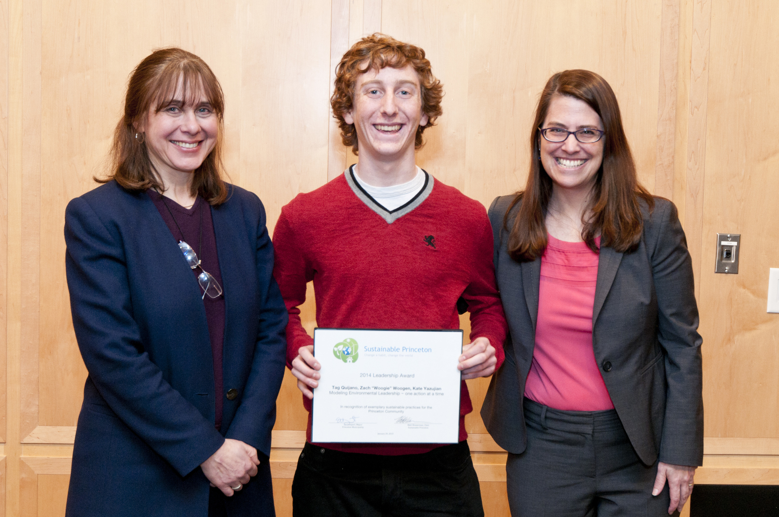 "Zach ""Woogie"" Woogen (center) accepting award on behalf of himself, Kate Yazujian and Tag Quijano (not pictured) with Sustainable Princeton Vice-Chair, Heidi Fichtenbaum (left) and Mayor Liz Lempert (right). Photo by Cyndi Shattuck."