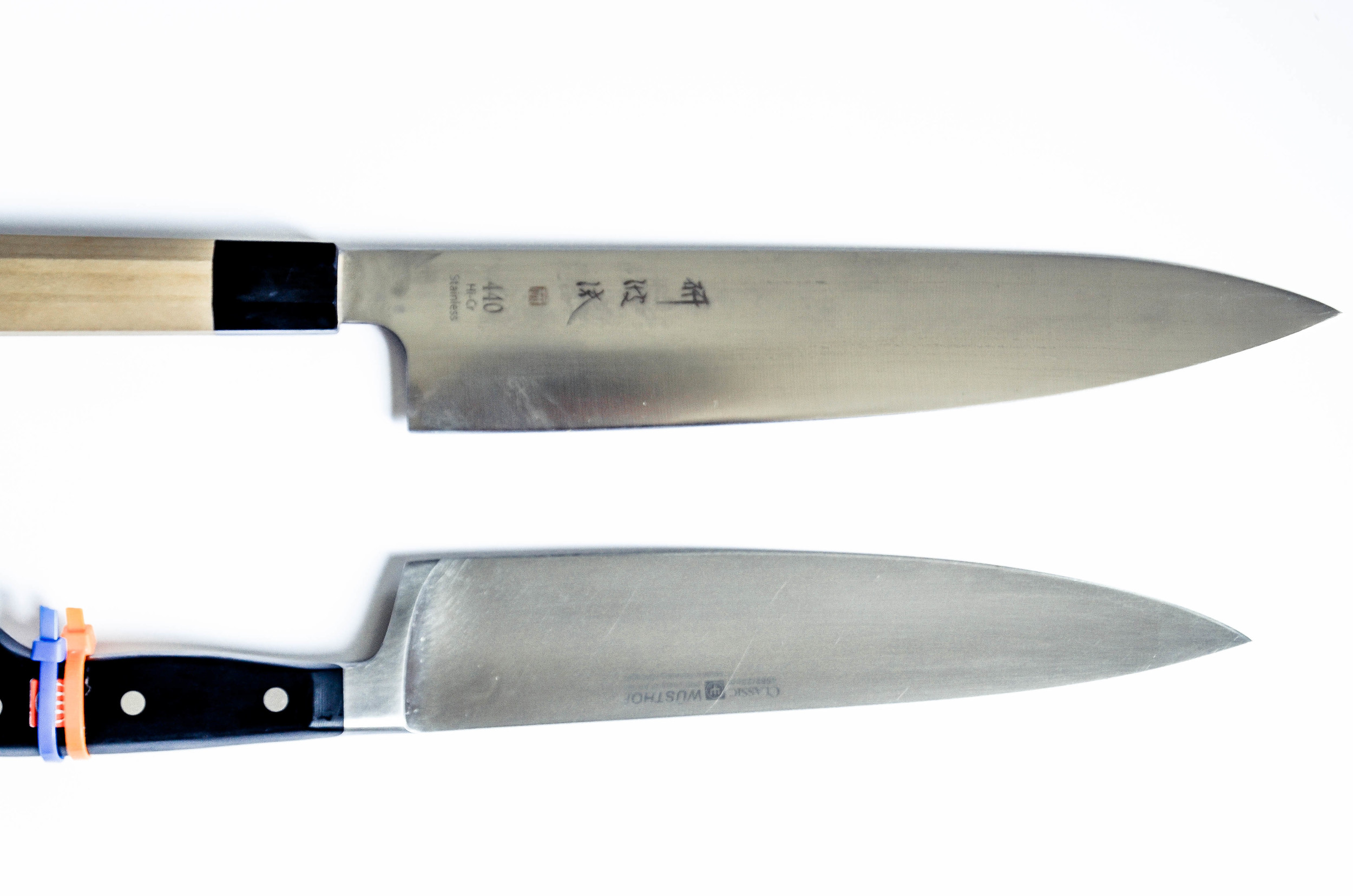 i actually have two chef's knives - the top is a western-style japanese blade from  korin . the bottom is my school-issue wusthof blade.