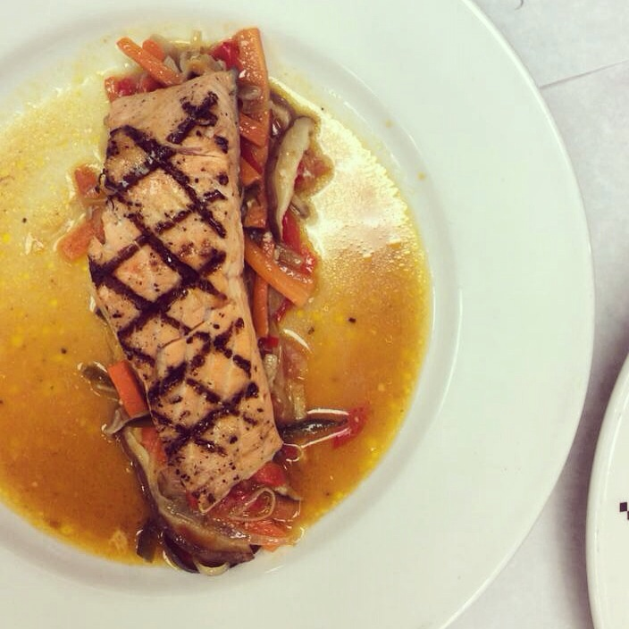 grilled tranche of salmon with steamed vegetable medley