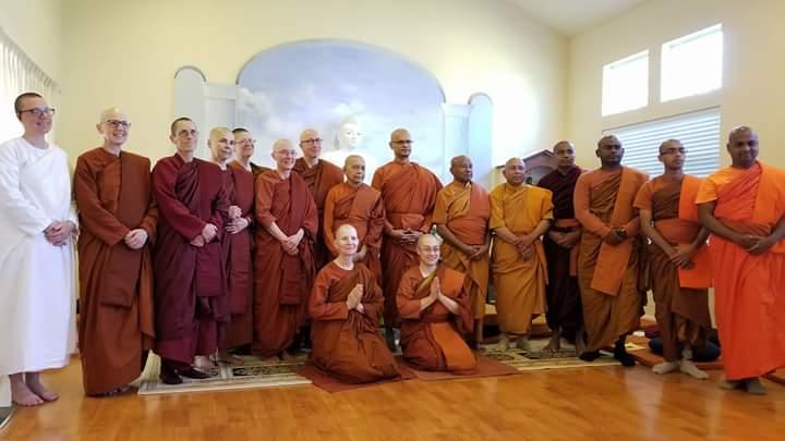 Ven. Dhammadipa (also known as Konin) kneeling on left, Ven. Cittananda kneeling on right
