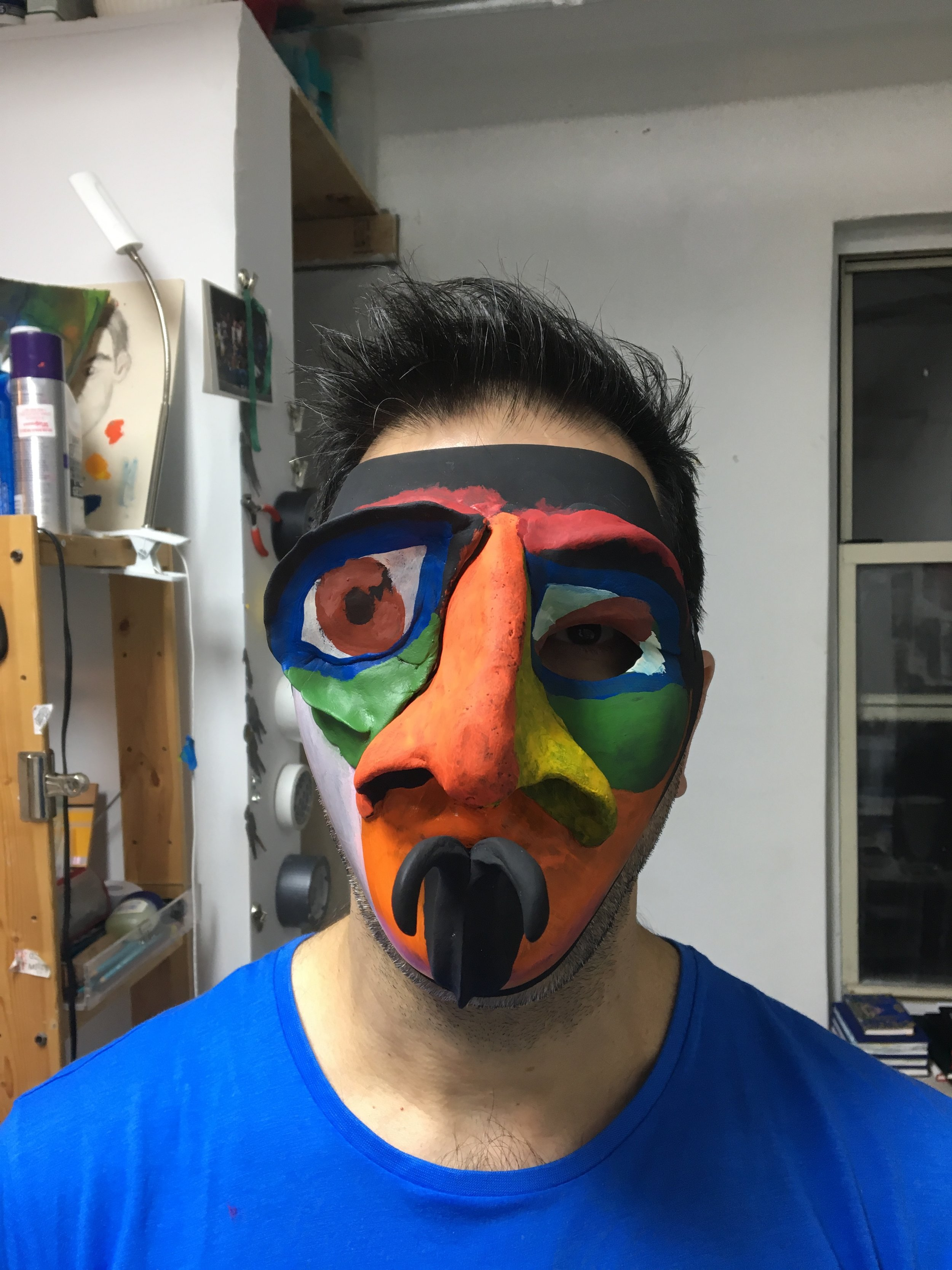 Alex wearing a mask idea that came from these drawings.