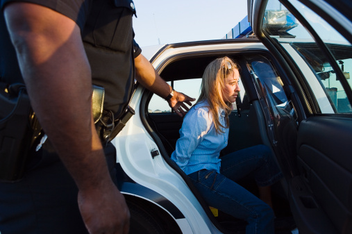 female in squad car.jpg