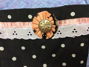 Here is a beautifully hand sewn yo-yo.