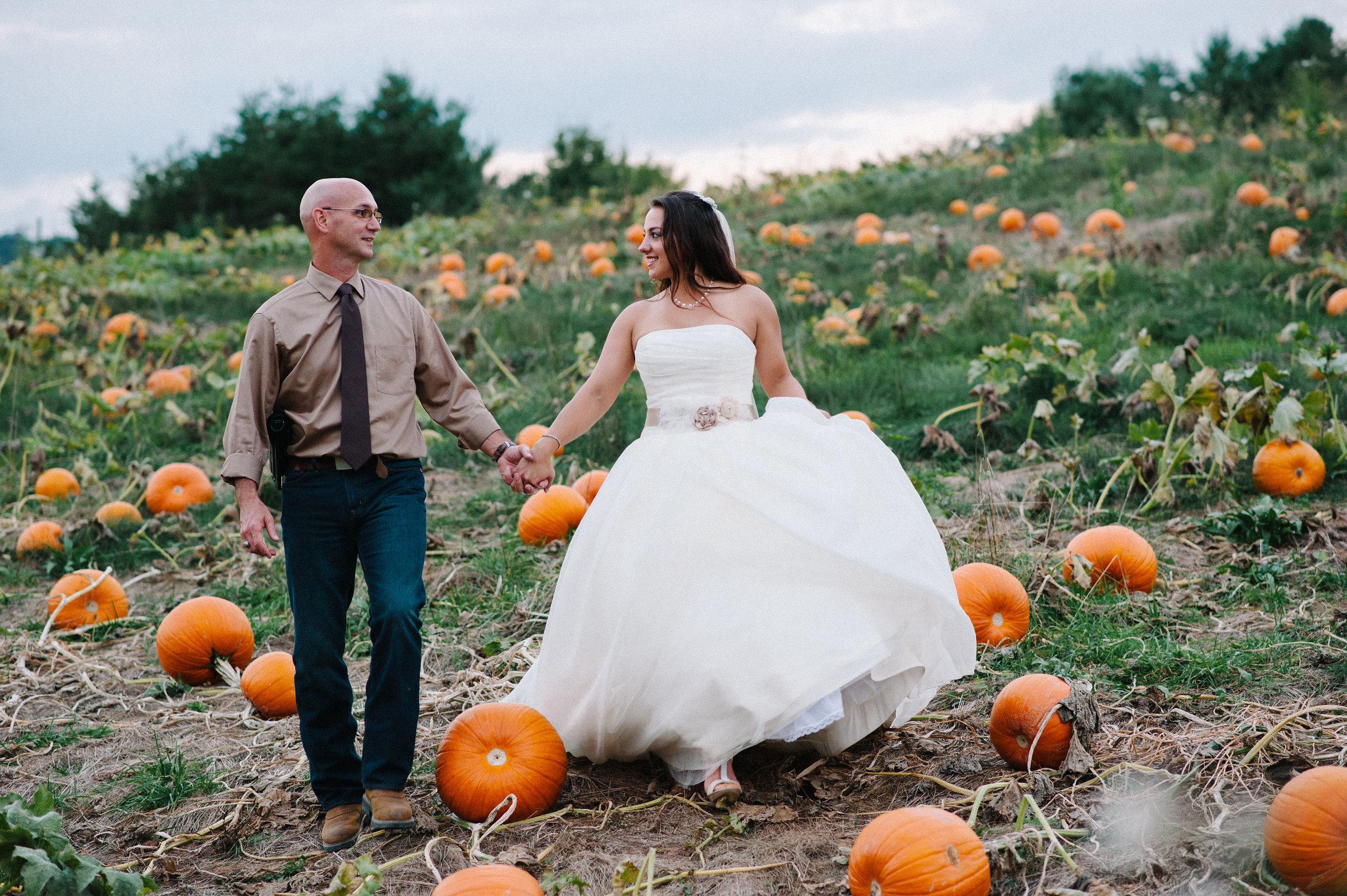 bride-and-groom-walking-pumpkins.jpg