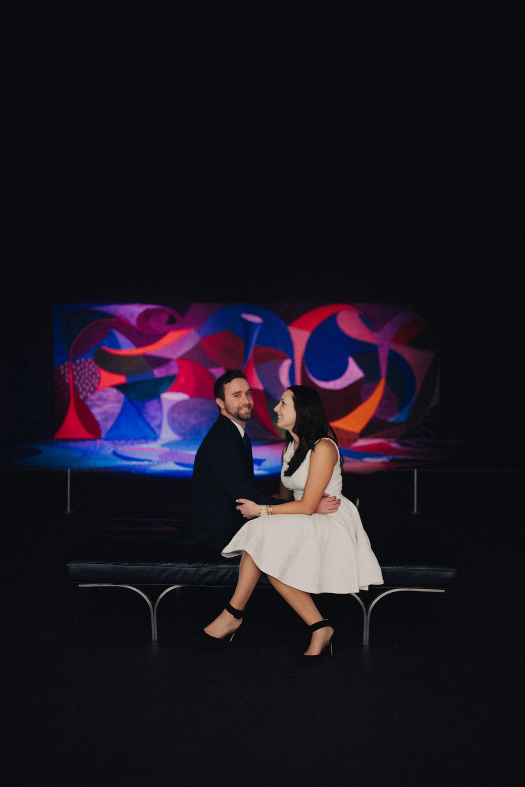 colorful engagement portrait in an art exhibit at the american art museum