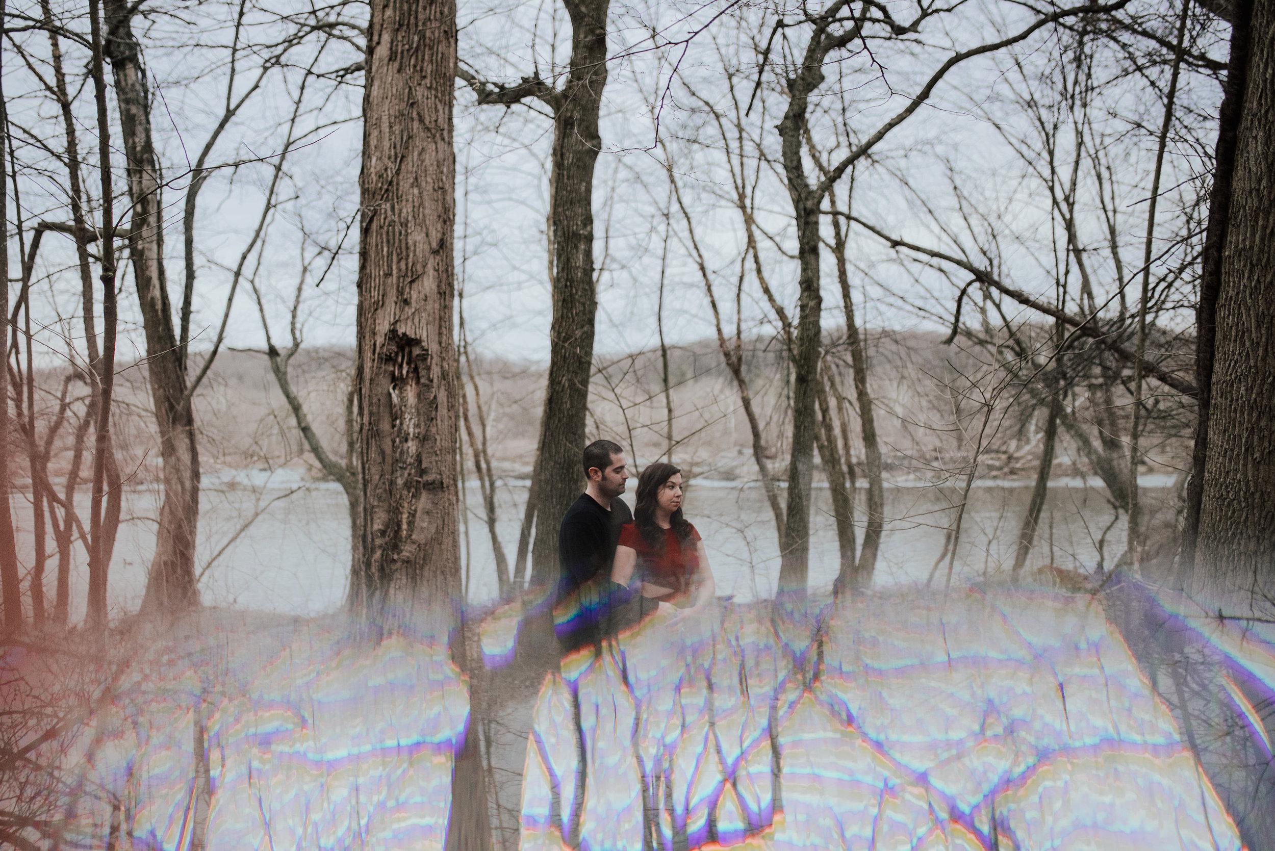 engagement portrait using a prism for reflection creating a unique composition