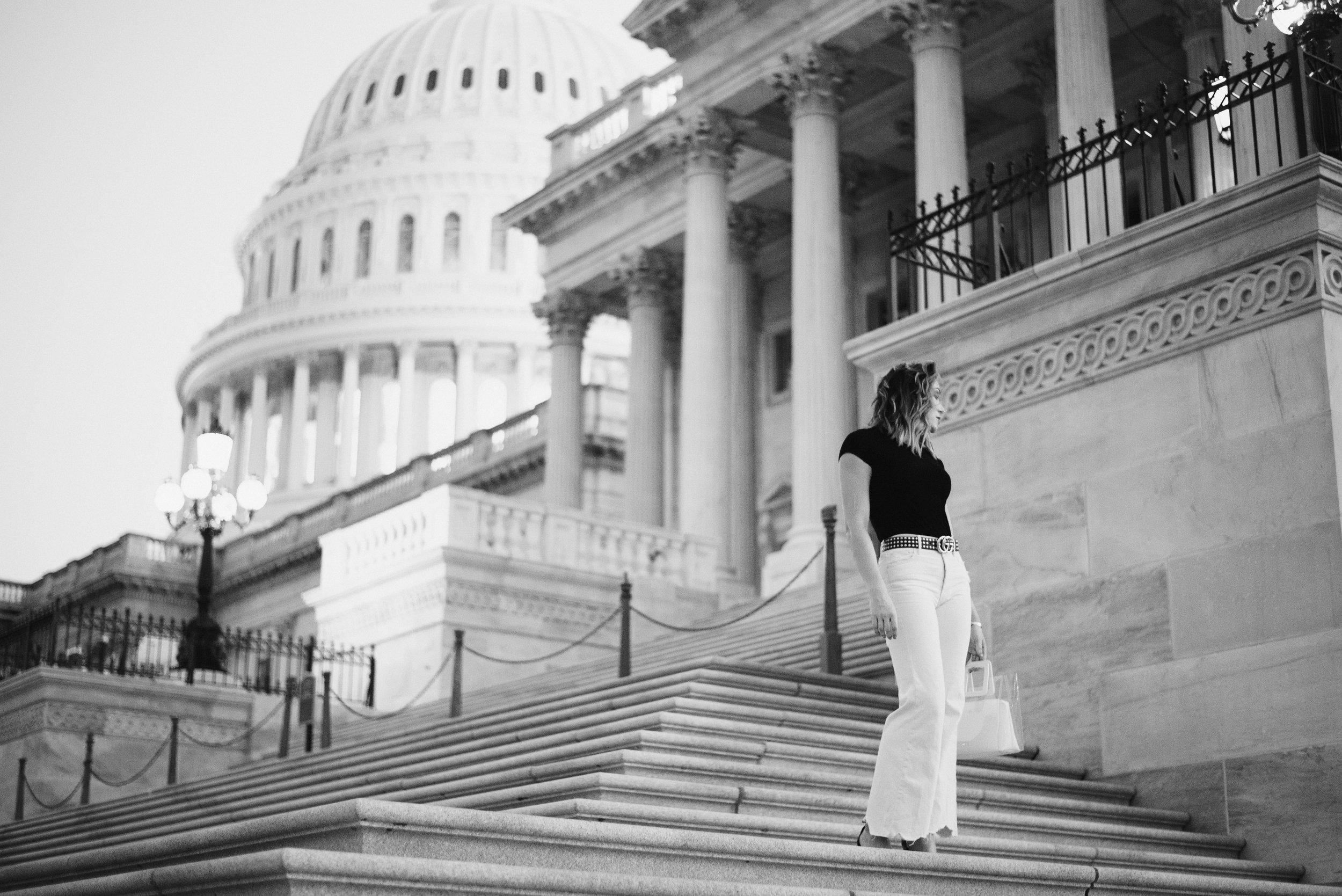 black and white photo of woman on steps of United States Capitol building in Washington, D.C.