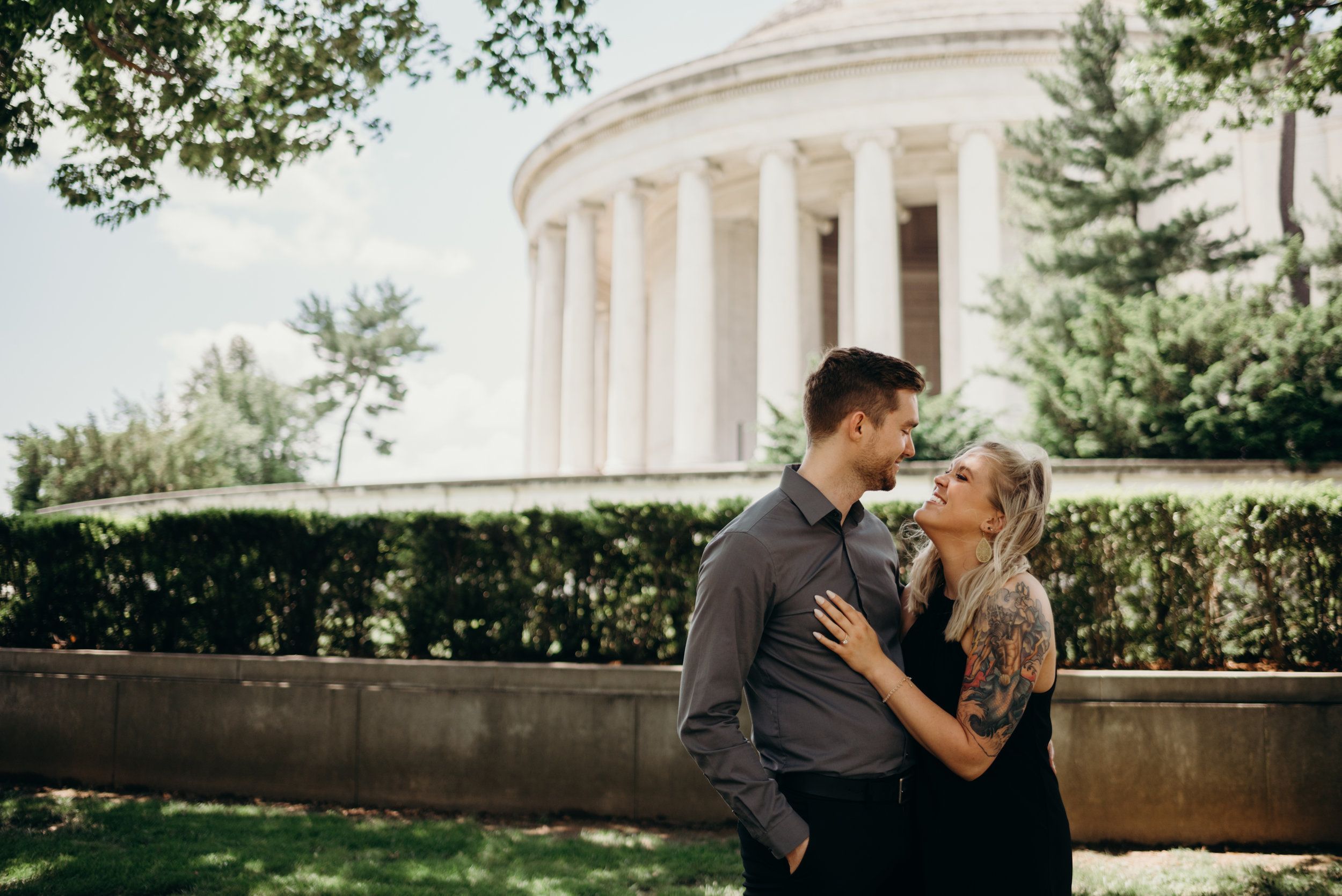 engaged couple posing in front of Thomas Jefferson Memorial