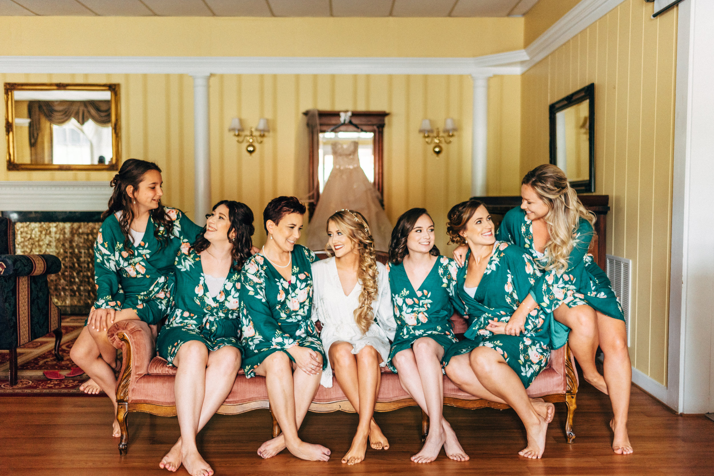 bride with her bridesmaids wearing robes before wedding at The Inn at the Old Silk Mill