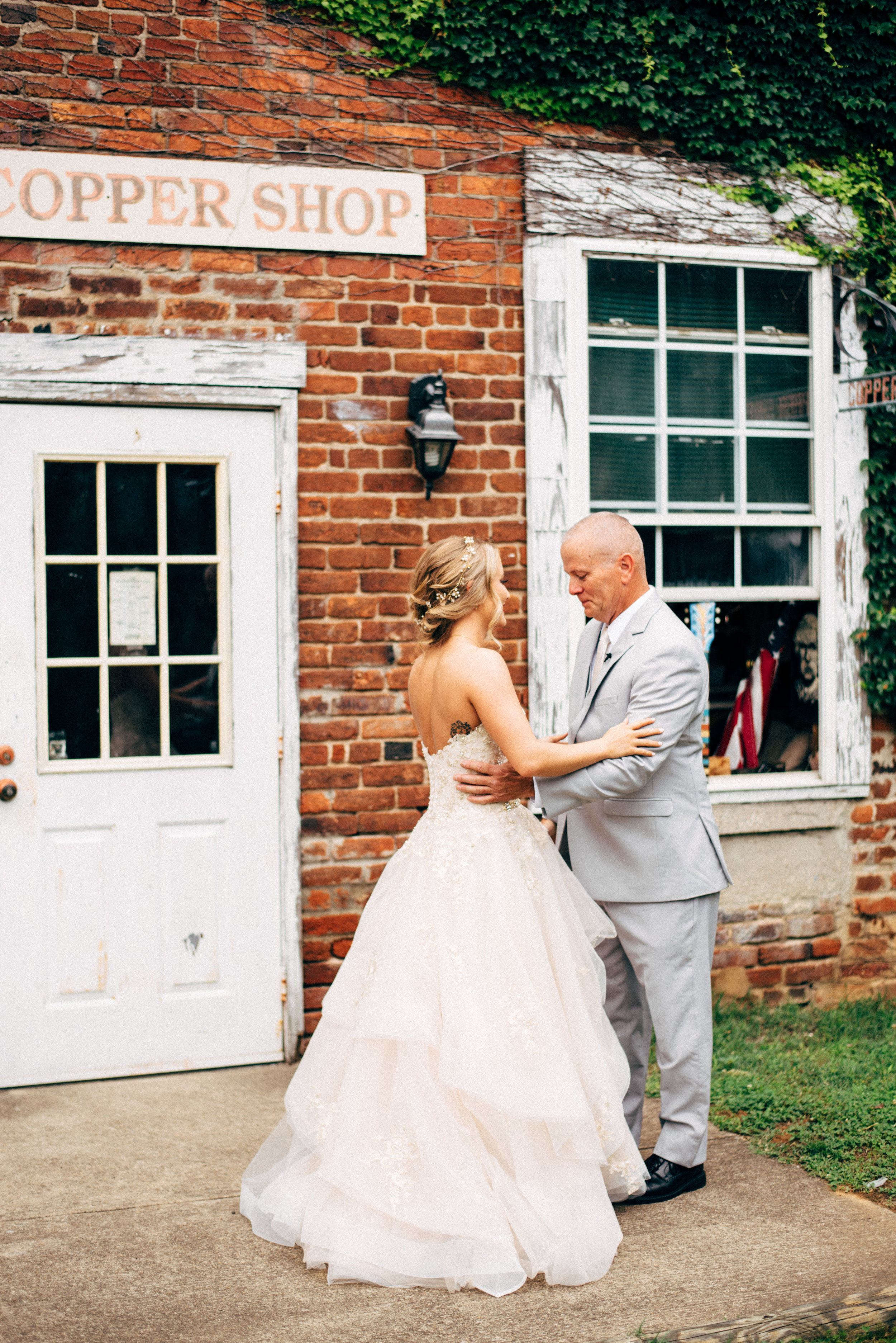 first look with dad and daughter before wedding ceremony