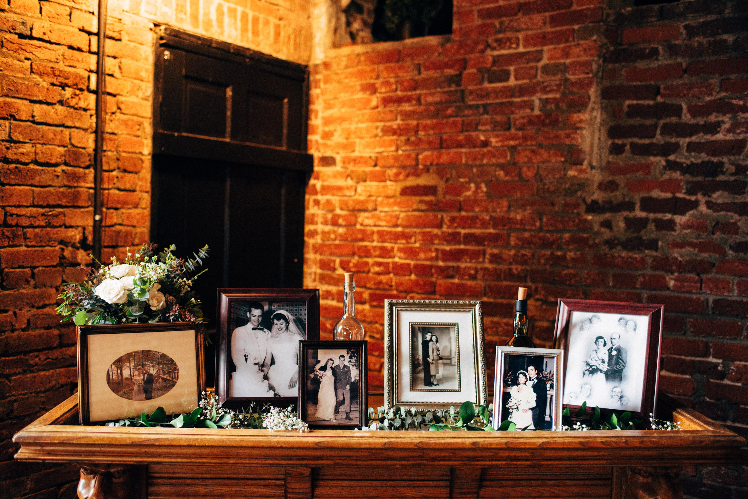 photos of parents' wedding photos at wedding reception at the Inn at the Old Silk Mill