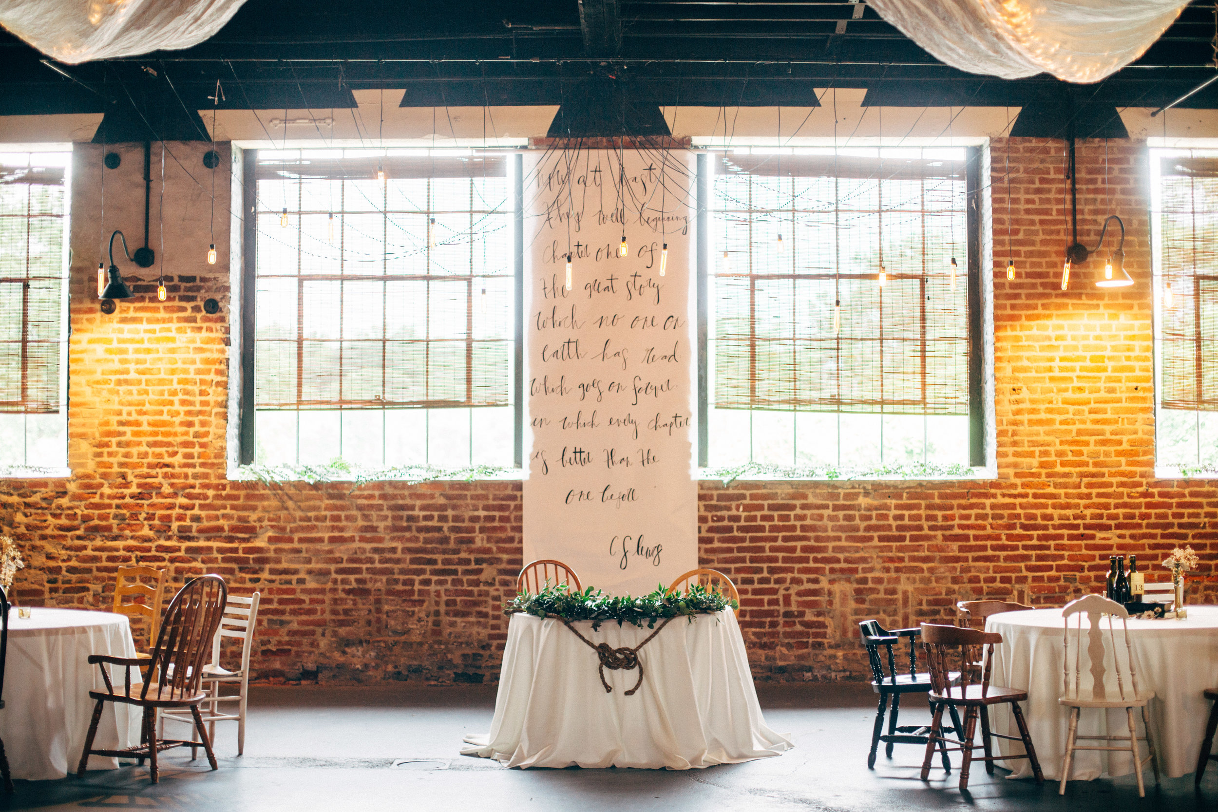 bride and groom's table at their wedding reception at the Inn at the Old Silk Mill