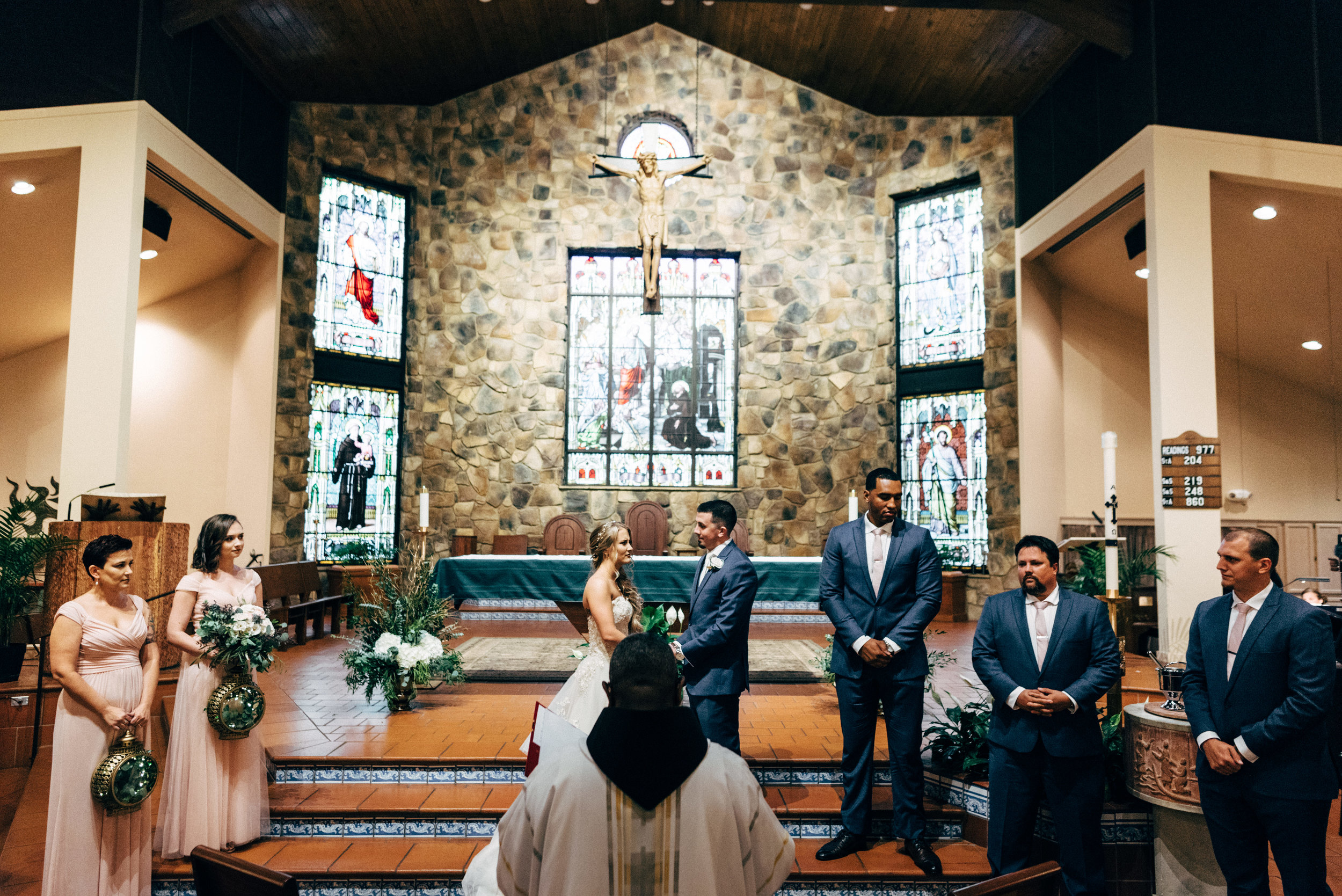 bride and groom during wedding ceremony at St. Francis of Assisi Catholic Church in Triangle, Virginia