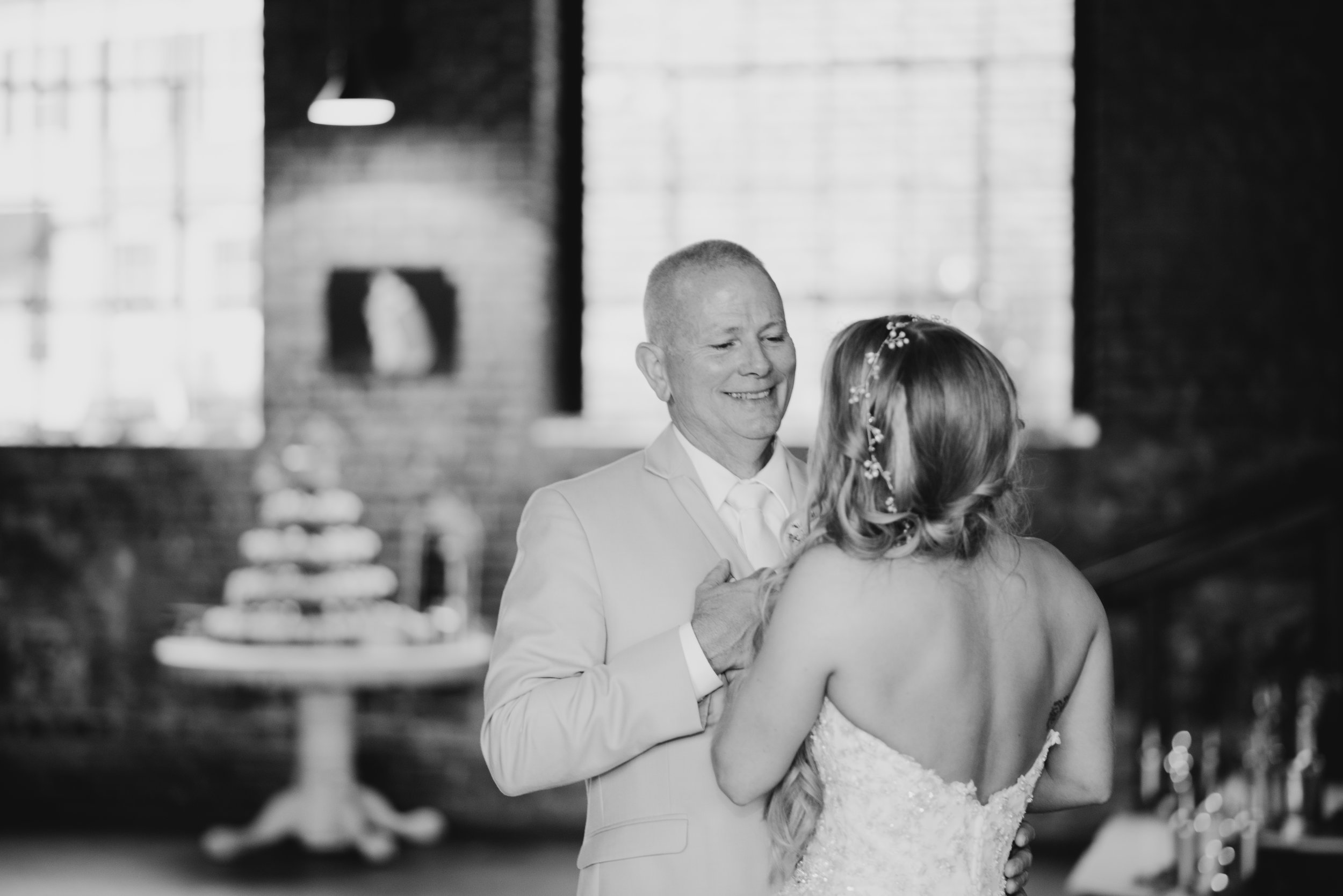 bride and her father dance at wedding reception at the Inn at the Old Silk Mill