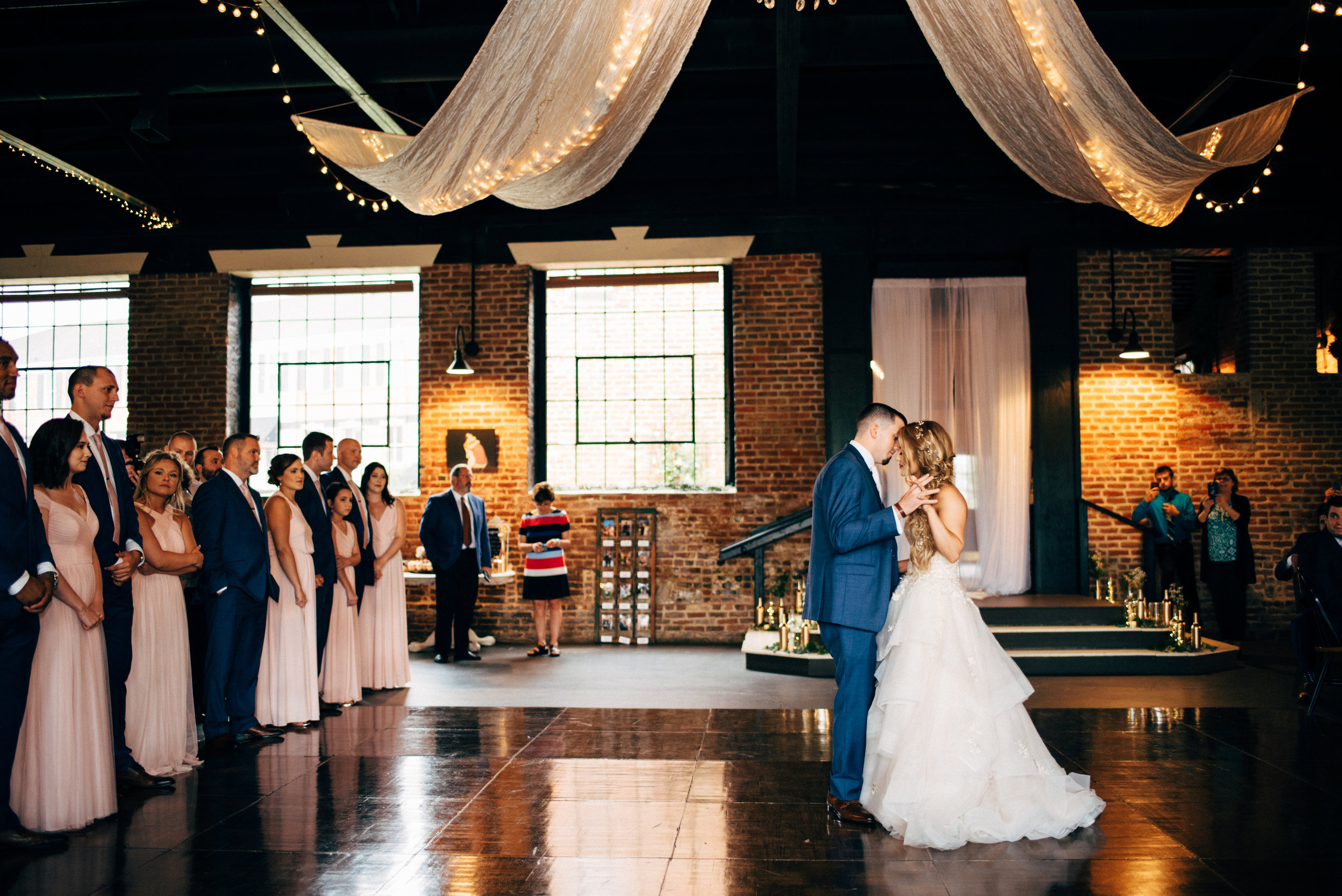 bride and groom first dance during wedding reception at the Inn at the Old Silk Mill