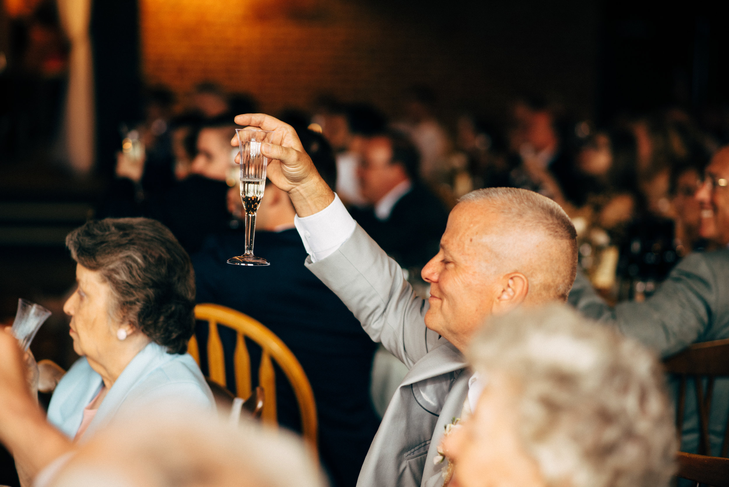 father of the bride toasts newly married couple during wedding reception