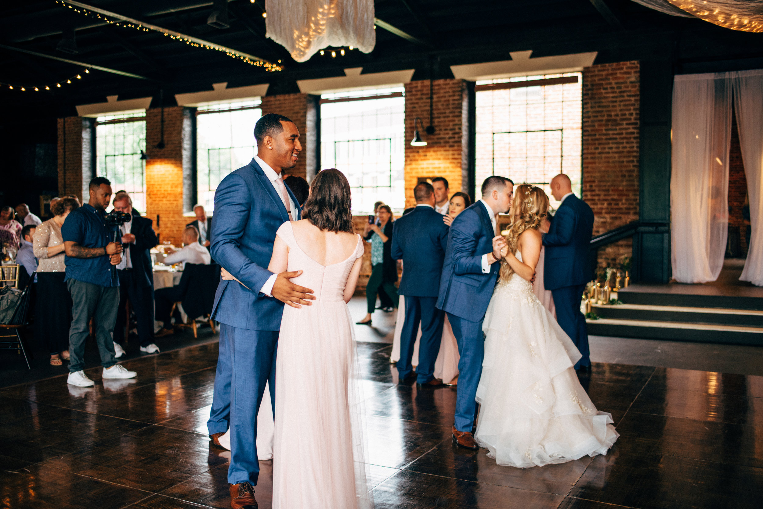 bridal party dancing during wedding reception at the Inn at the Old Silk Mill