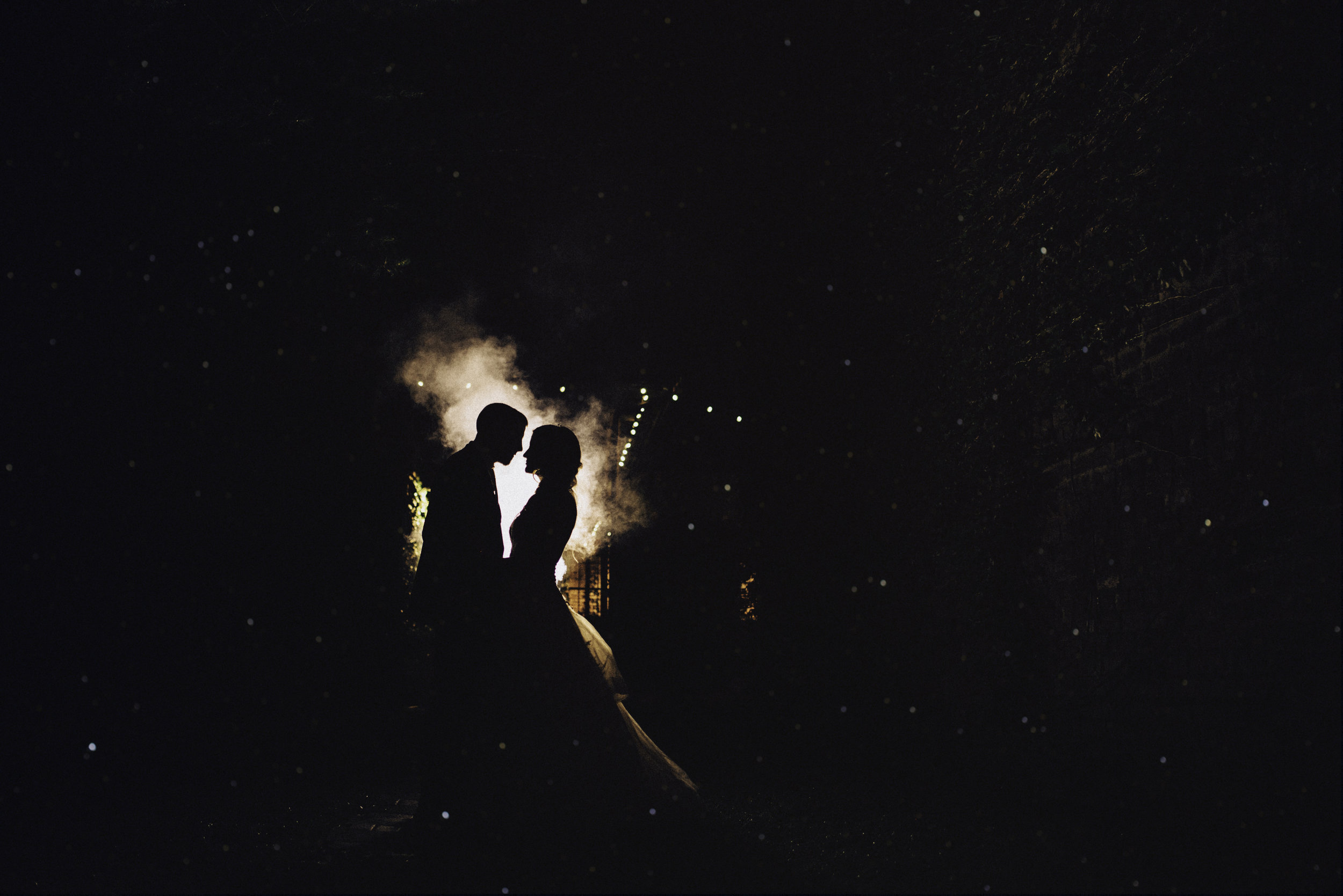 silhouette of bride and groom at night after fairytale wedding at The Inn at the Old Silk Mill