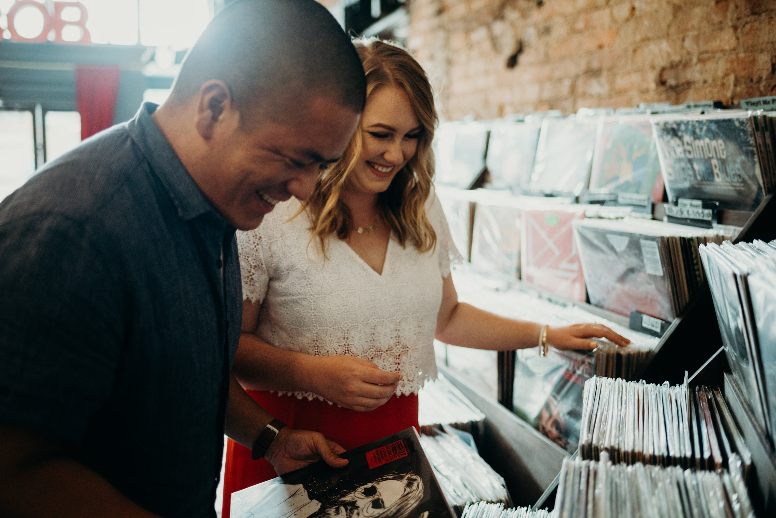 engagement photo session shopping for records at Songbyrd in Washington, D.C.
