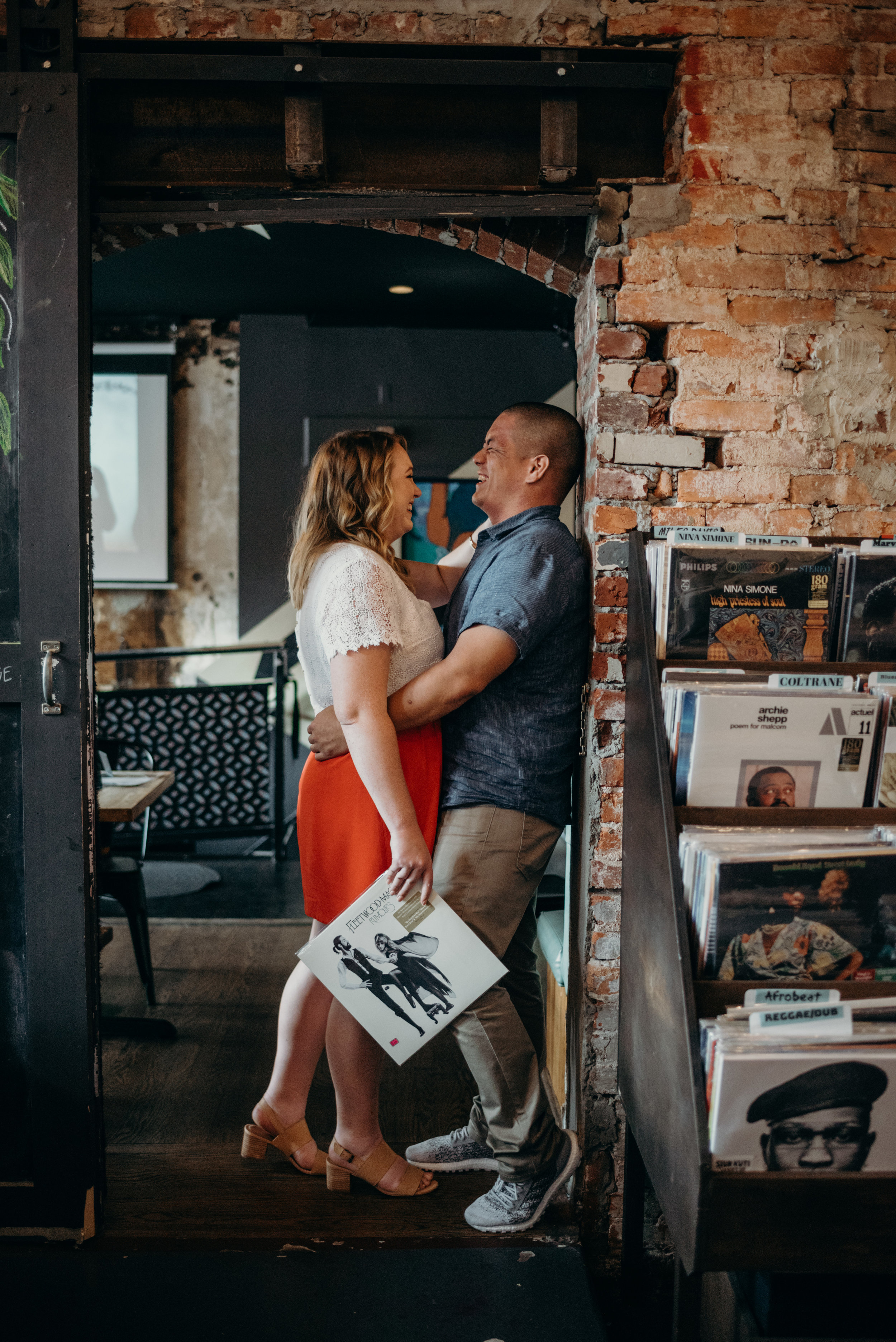 couple laughing and hugging during engagement photo session