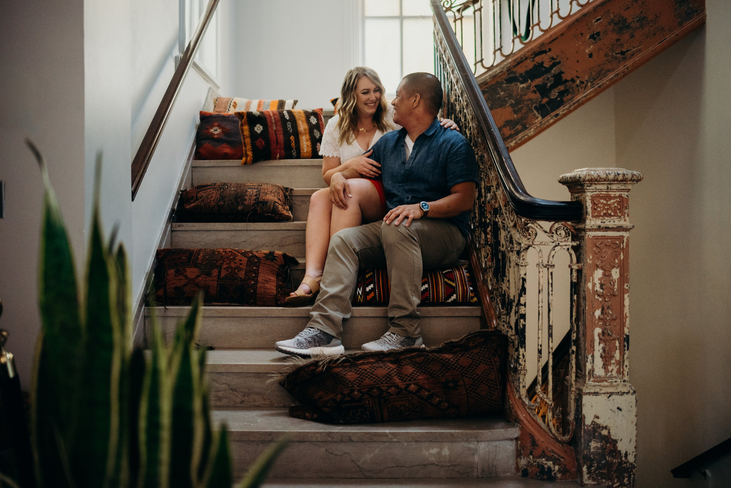 engaged couple sitting on stairs in LINE hotel lobby in Washington DC