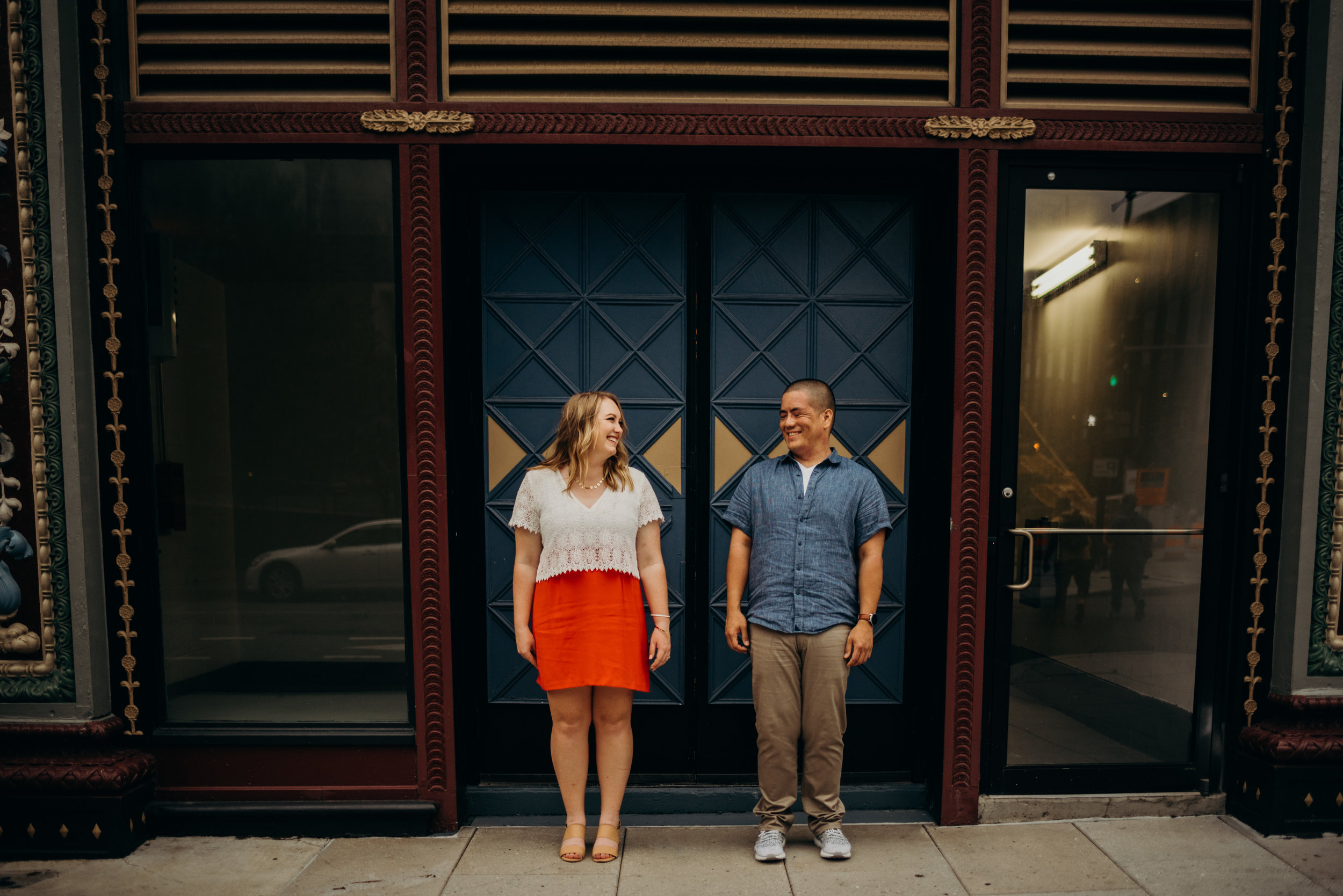 engagement photo taken in front of blue and gold doors in Washington, DC