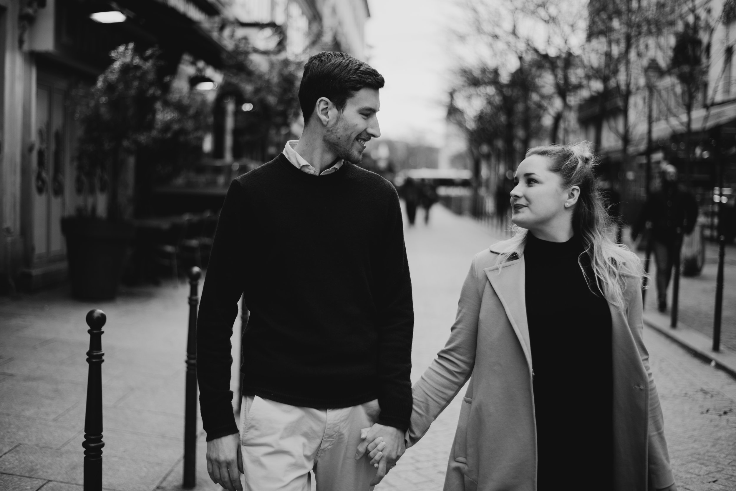 married couple walking down streets of Paris, France on their honeymoon