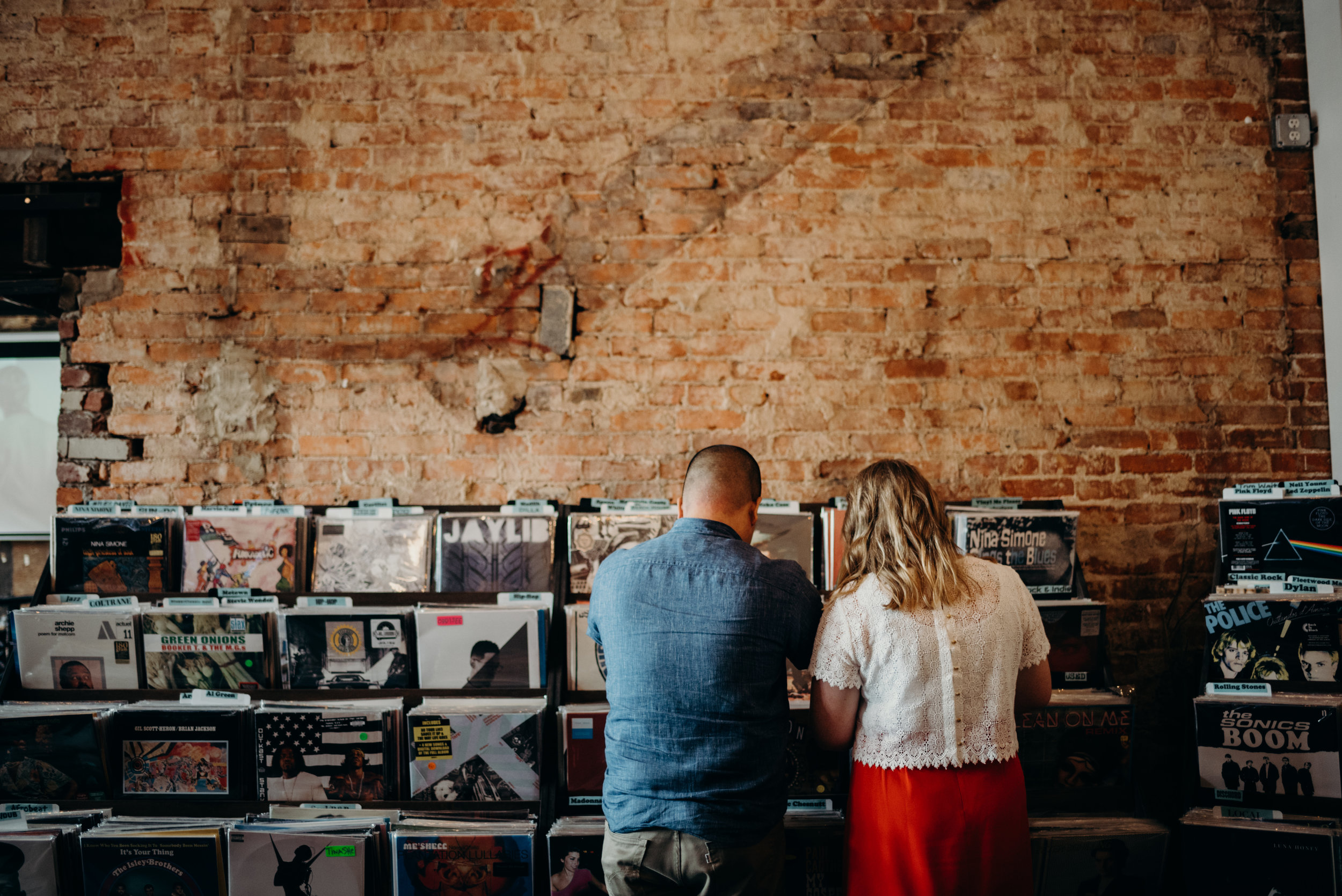 engagement photo session at Songbyrd record store in Washington, DC