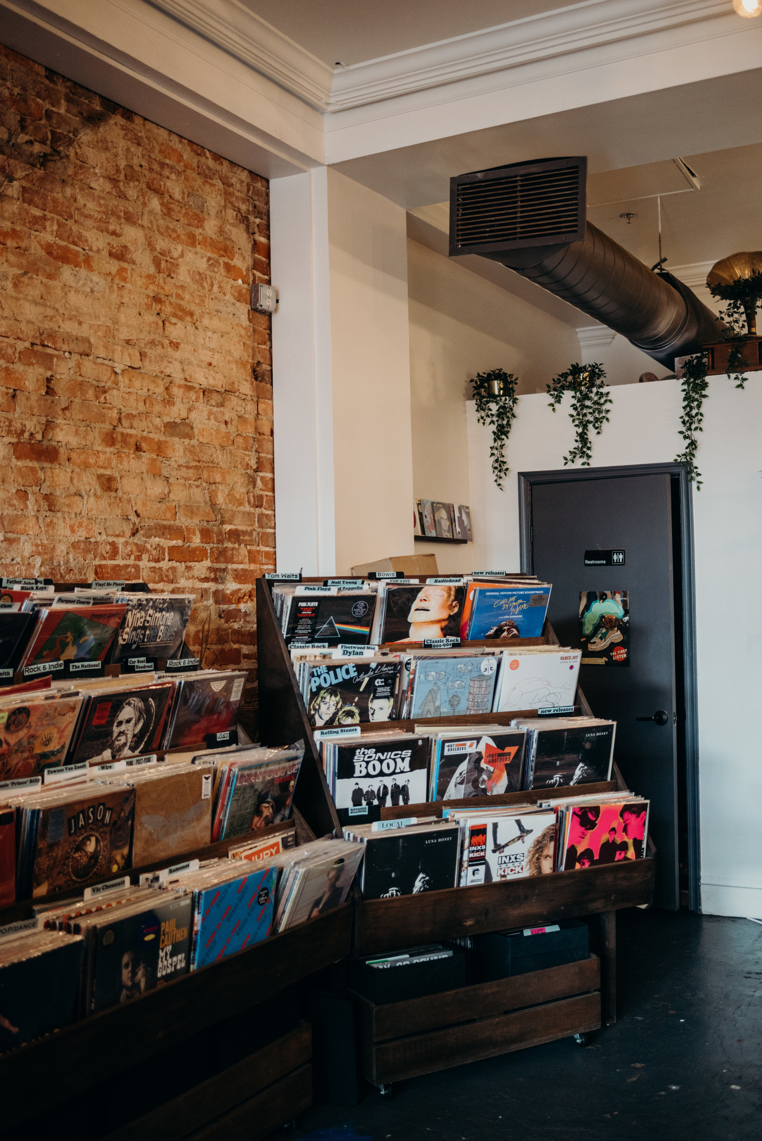 brick wall with a shelf of records at a record store in Washington, D.C.