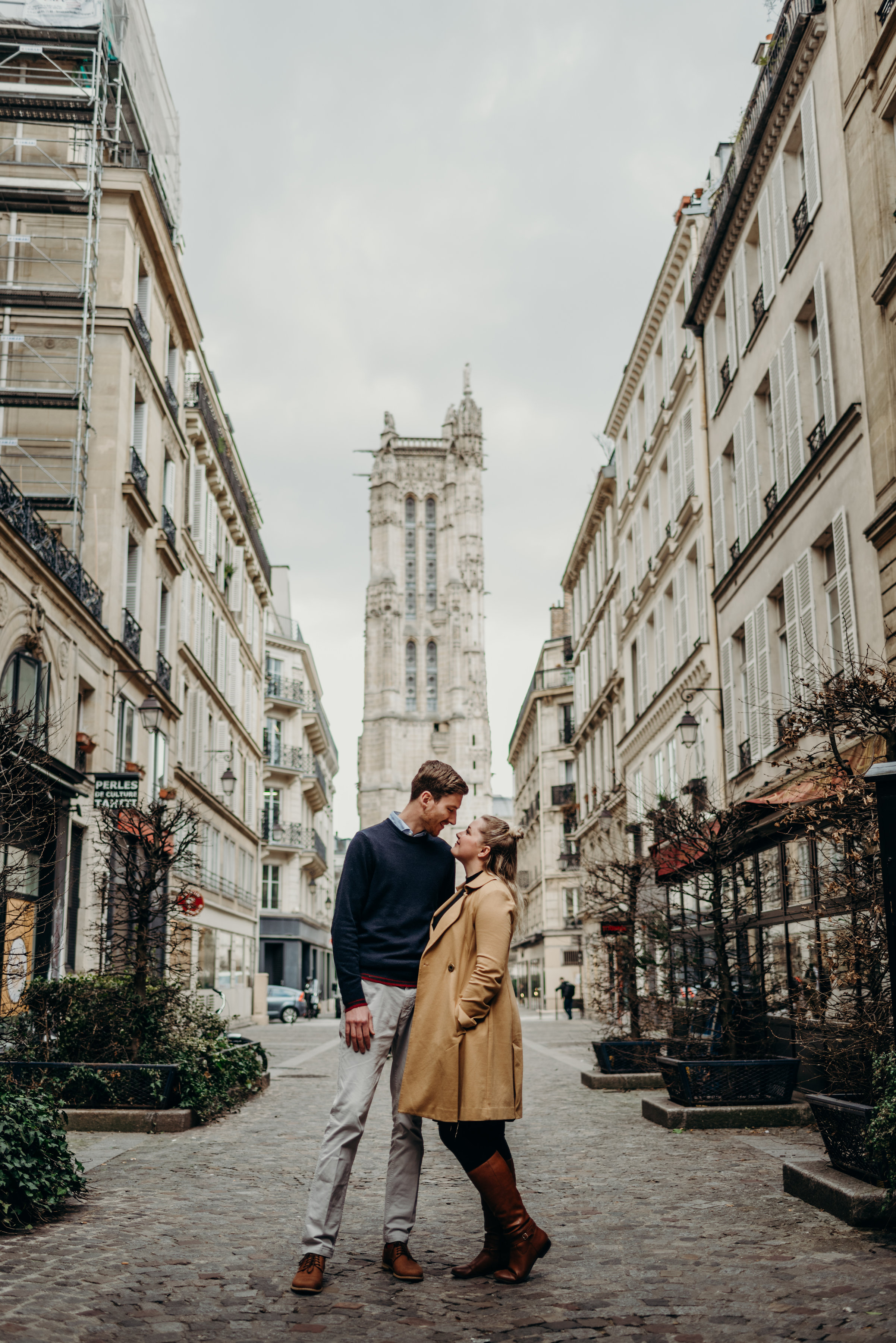 couple looking in each others' eyes in the streets of Paris, France on their honeymoon