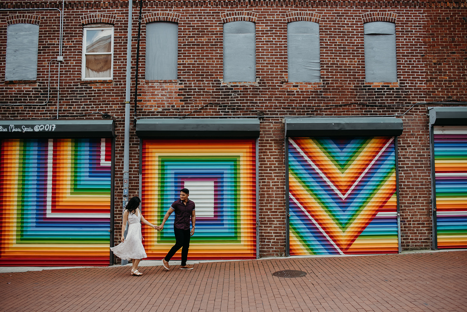 Washington DC love mural engagement session colorful rainbow skipping