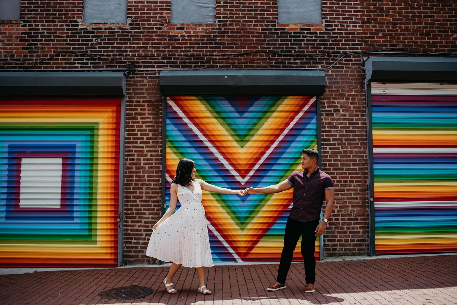Washington DC love mural engagement session colorful rainbow dance